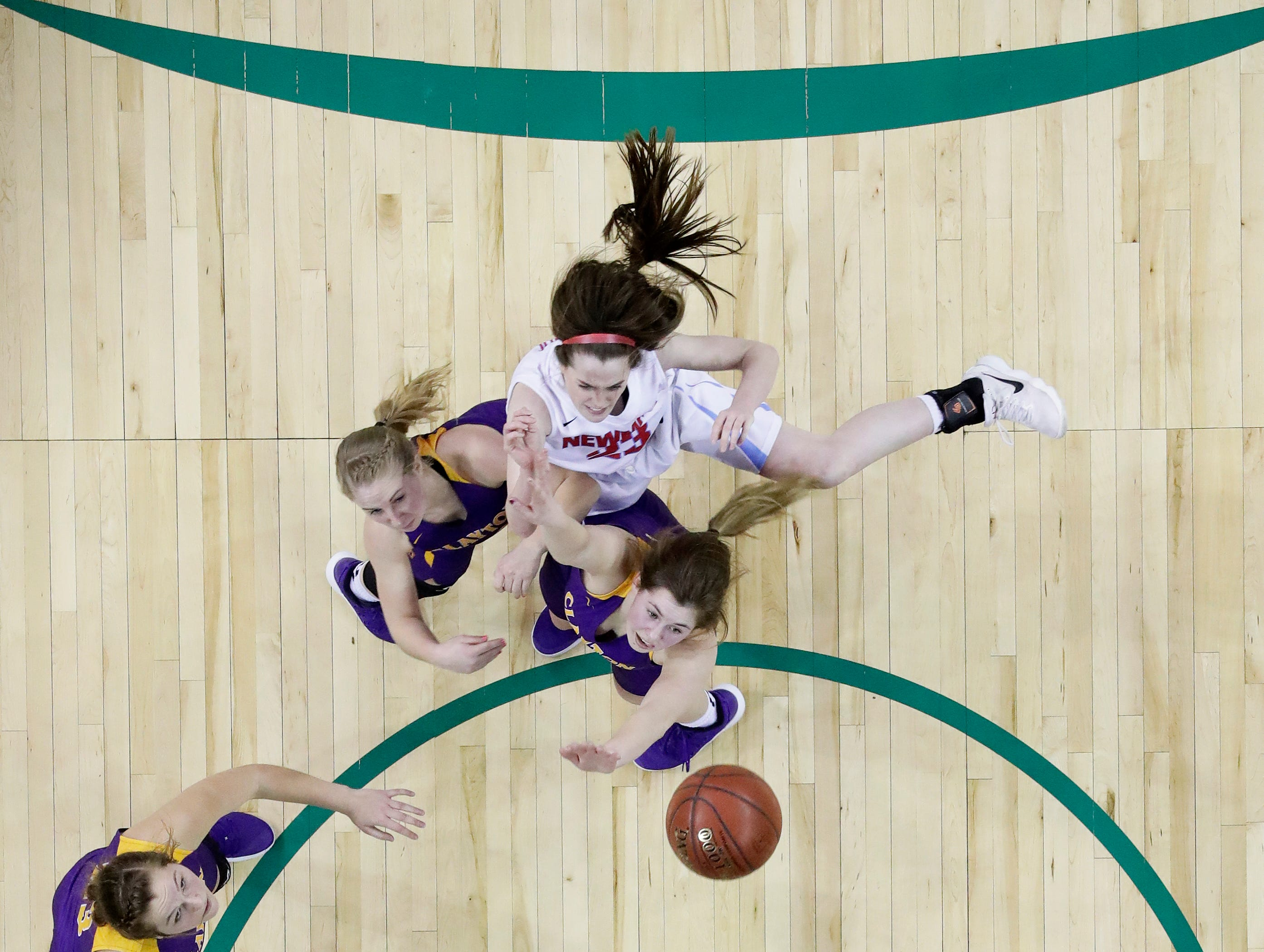 Wausau Newman Catholic's Lauren Shields (23) shoots against Clayton in a Division 5 semifinal at the WIAA state girls basketball tournament at the Resch Center on Friday, March 8, 2019 in Ashwaubenon, Wis.