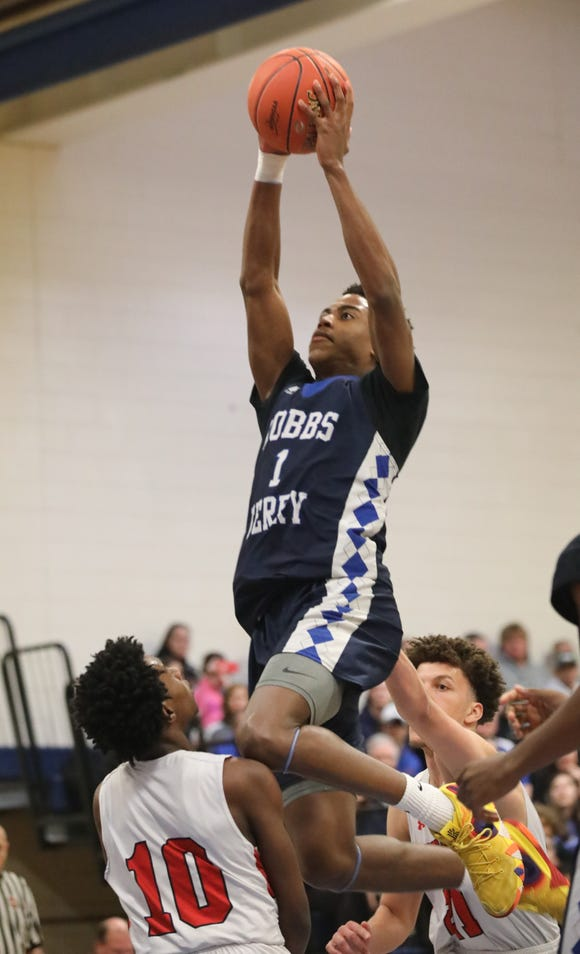 Dobbs Ferry's Dimaunie Meredith soars toward the basket during the Class B state regional final basketball game between Dobbs Ferry and Center Moriches at Centereach High School, March 9, 2019.