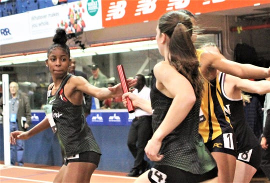 North Rockland's Jahlyah Goodbee takes baton from Haleigh Morales during 2019 New Balance Indoor Nationals girls DMR.