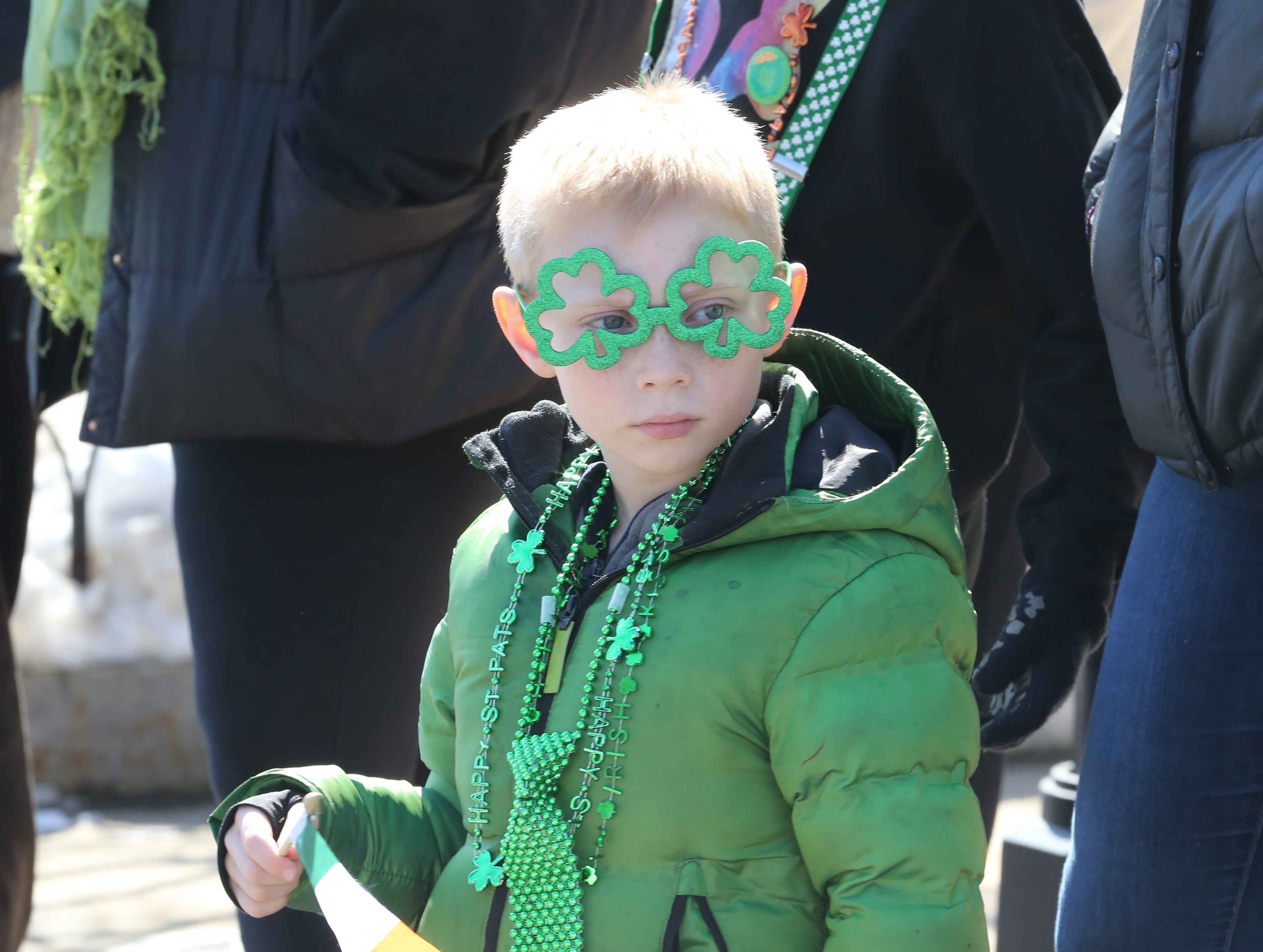 Ryan Bierfeldt, 6, dresses in green to watch the 22nd annual White Plains St. Patrick's Day parade along Mamaroneck Avenue in White Plains March 9, 2019.