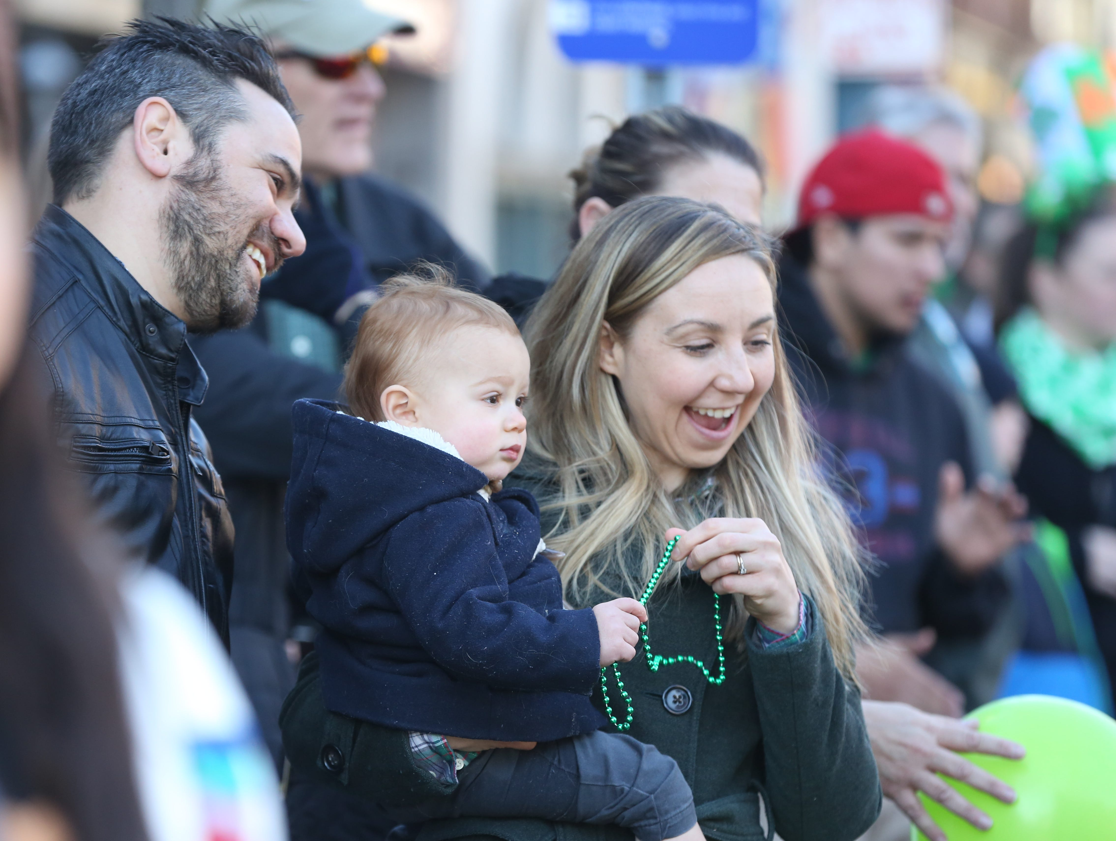 Arran Skinner, wife Melissa Skinner and 18-month-old son, Oscar enjoy the 30th Annual Peekskill St. PatrickÕs Day Parade in Peekskill March 9, 2019.