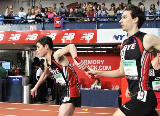 Rye's John Goldszer (r) hands baton to Thiago Hammes (l) during the 2019 New Balance Indoor Nationals boys EE 4x800 relay.