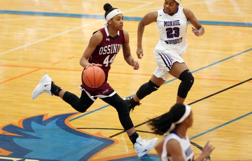Ossining's Aubrey Griffin (44) moves the ball up the court against Monroe-Woodbury during the girls regional final at SUNY New Paltz Match 9, 2019. Ossining won the game 67-34.