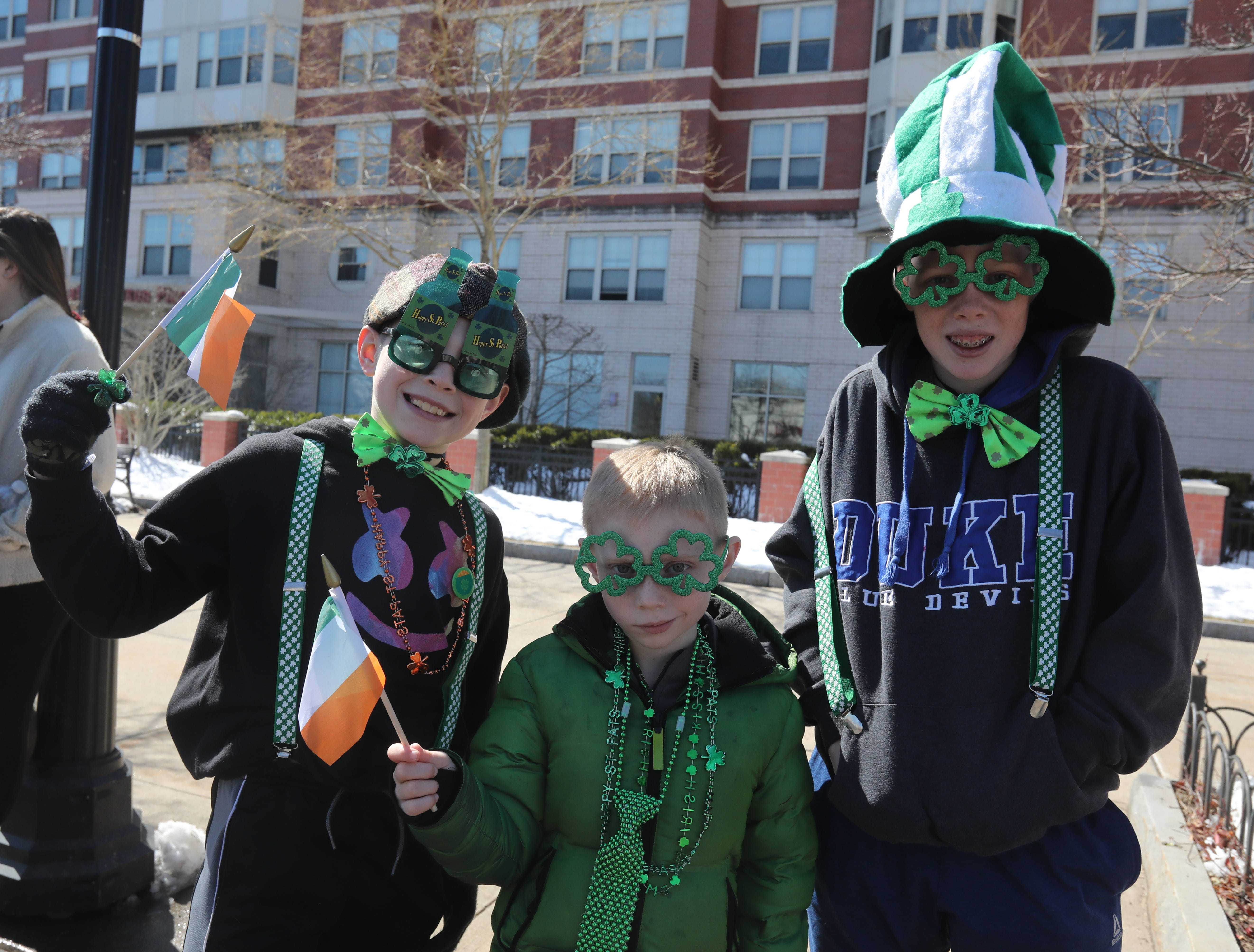 From left, brothers Devin Bierfeldt, 9, Ryan Bierfeldt, 6, and Connor Bierfeldt, 12, wait for the start of the 22nd annual White Plains St. Patrick's Day parade along Mamaroneck Avenue in White Plains March 9, 2019.
