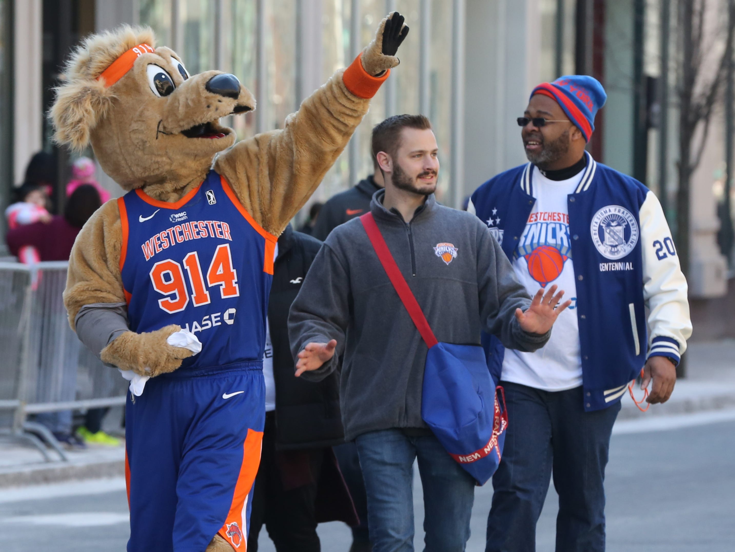 Westchester Knicks mascot waves to the crowd during the 22nd annual White Plains St. Patrick's Day parade along Mamaroneck Avenue in White Plains March 9, 2019.