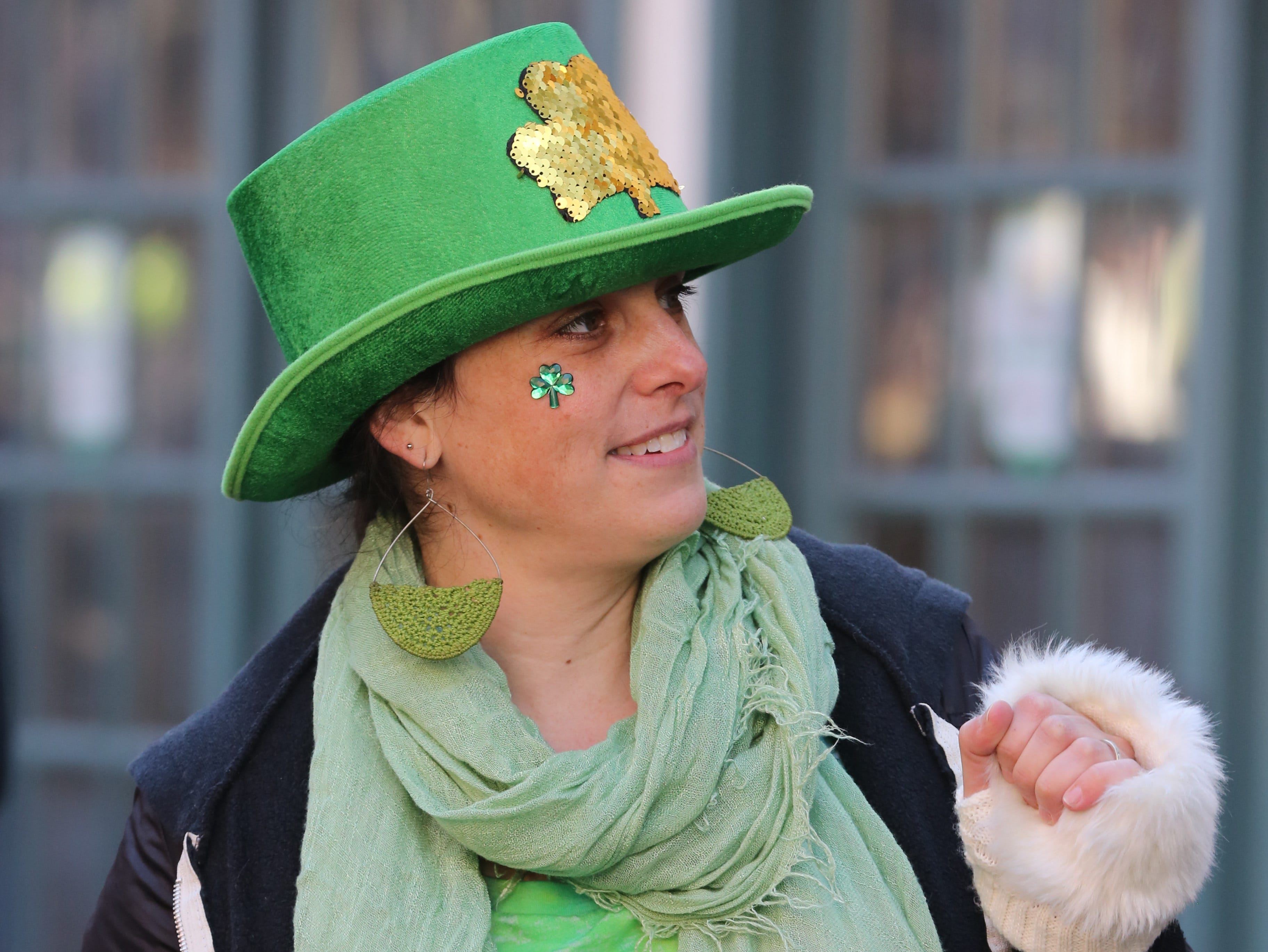 Michele Farrie dances during the 30th Annual Peekskill St. PatrickÕs Day Parade in Peekskill March 9, 2019.