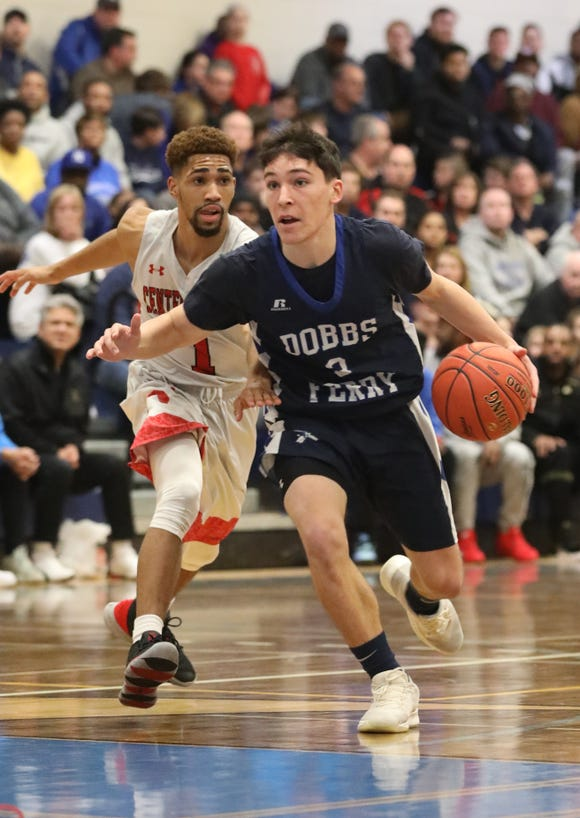 Dobbs Ferry's Jack Baglieri moves the ball down court during the Class B state regional final basketball game between Dobbs Ferry and Center Moriches at Centereach High School, March 9, 2019.
