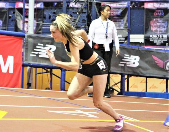 Bronxville's Caroline Ircha bursts from blocks at start of girls 4x200 relay during 2019 New Balance Indoor Nationals.