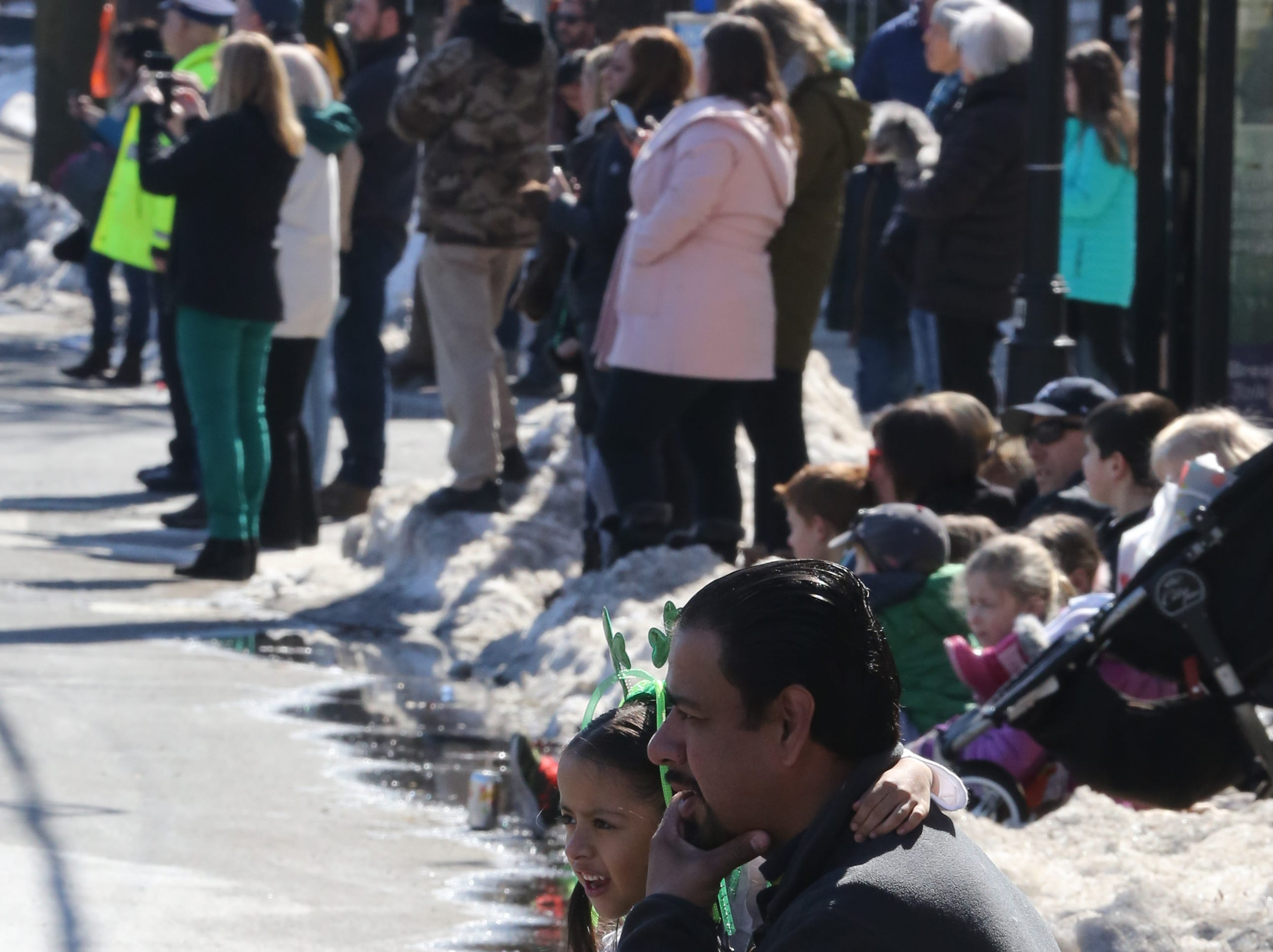 Juan Carlos Heredia and his daughter, Carolyn Heredia, 5 watch the bands during the 22nd annual White Plains St. Patrick's Day parade along Mamaroneck Avenue in White Plains March 9, 2019.