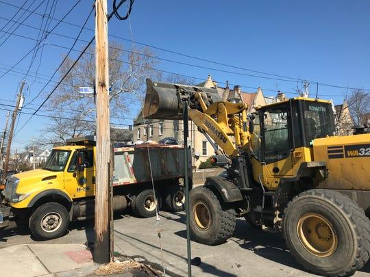 Mount Vernon DPW front-end loader lifts trash into dump truck