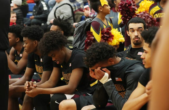 The Mount Vernon bench can't watch as Kingston celebrates their 69-38 victory in the boys regional final at SUNY New Paltz Match 9, 2019.