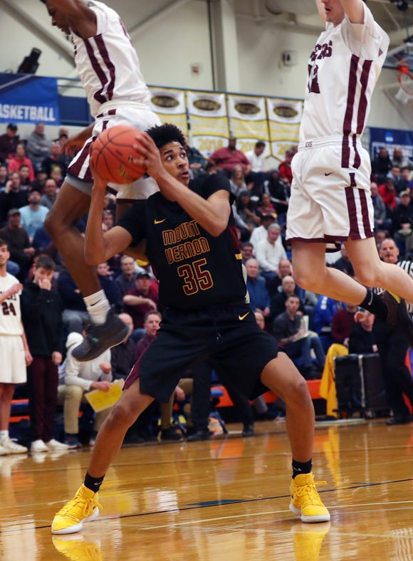 Mount Vernon's Julius Cobbs (35) tries to get a shot off while surrounded by Kingston defenders, during the boys regional final at SUNY New Paltz Match 9, 2019. Kingston won the game 69-38.