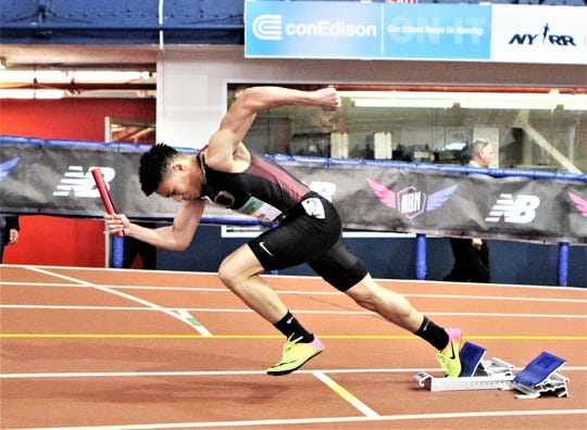 Ossining's Brandon Raysor breaks out of the blocks at the start of the boys championship 4x200 trial during the 2019 New Balance Indoor Nationals.
