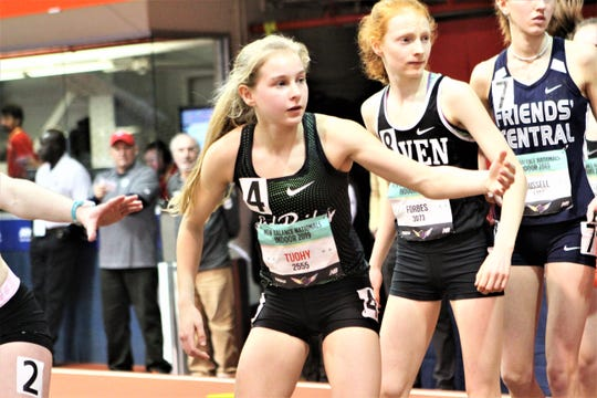 Katelyn Tuohy waits for the baton during the 2019 New Balance Indoor Nationals girls distance medley relay. Tuohy passed five runners as North Rockland won its fourth straight national title in the event.