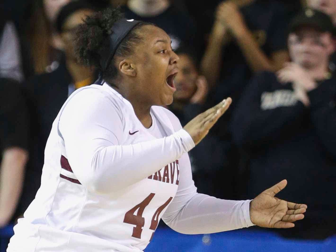 Caravel's Kendra Warren reacts after scoring while she was fouled in the first half of the DIAA state tournament championship game at the Bob Carpenter Center Friday.