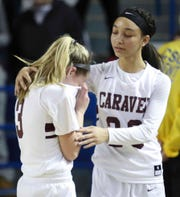 Caravel's Karli Cauley, left, is consoled by teammate India Johnston after Sanford's 51-49 win in the DIAA state tournament championship game at the Bob Carpenter Center Friday.
