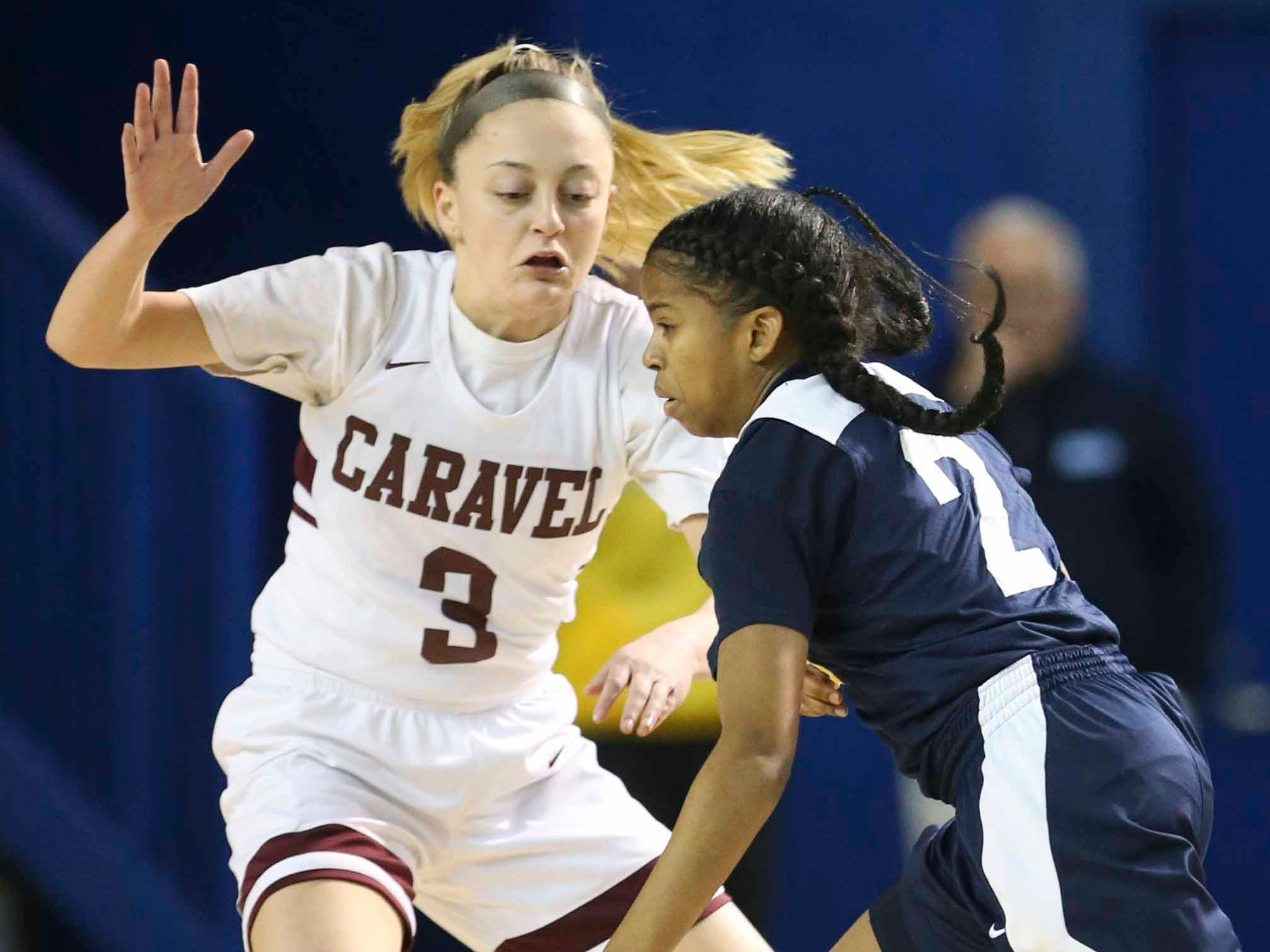 Caravel's Karli Cauley defends against Sanford's Lauren Park in the first half of the DIAA state tournament championship game at the Bob Carpenter Center Friday.