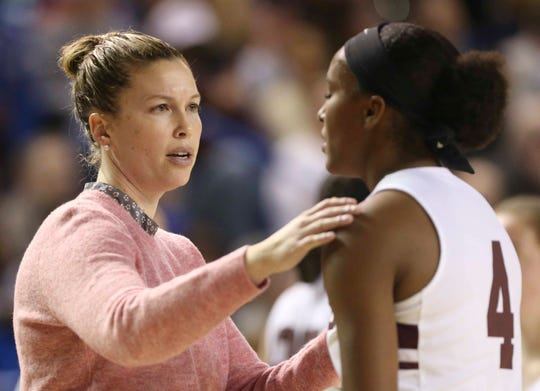 Caravel coach Kristin Caldwell advises Sasha Marvel in a break in the first half of the DIAA state tournament championship game at the Bob Carpenter Center in February.
