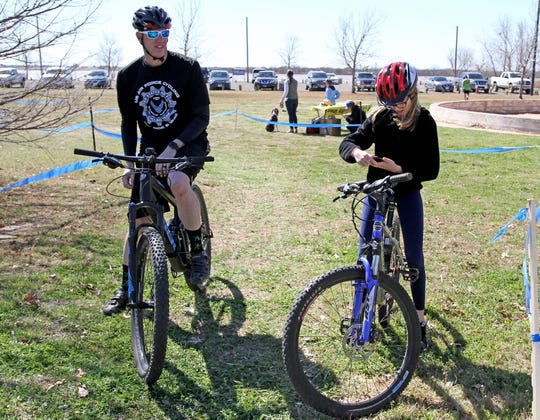 Jason Gracin and Paige rest after riding at the Bike and Seek event hosted by Bike Wichita Falls Saturday, March 9, 2019, at Lake Wichita.