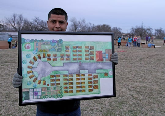 Carlos Cardoza, volunteer, holds a rendering of a completed Base Camp Lindsey during a camp out to raise awareness for homeless veterans Friday, March 8, 2019, at Base Camp Lindsey located at 1909 Old Windthorst Rd.