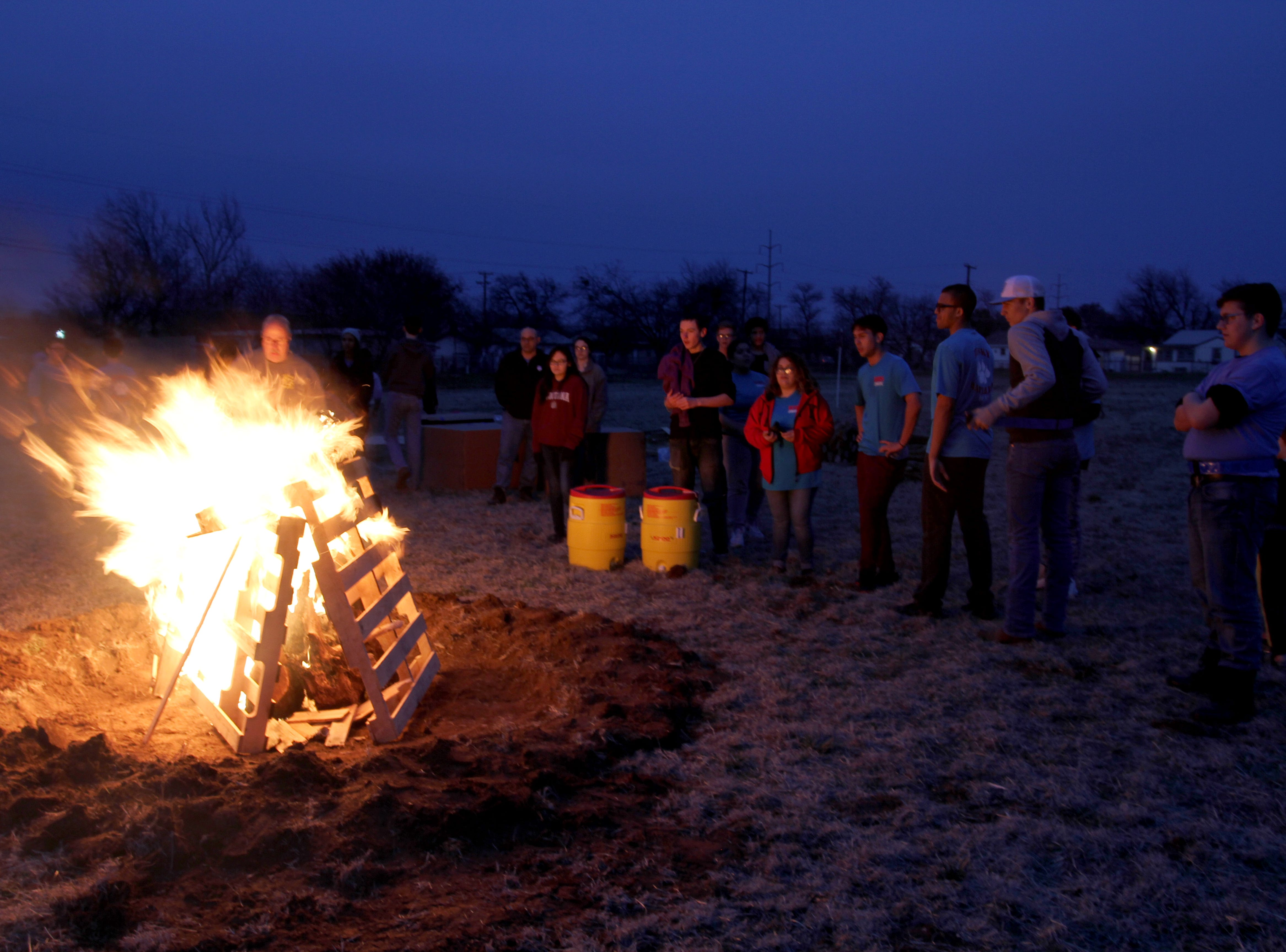 A bonfire is lit to keep people warm during a camp out to raise awareness for homeless veterans Friday, March 8, 2019, at Base Camp Lindsey located at 1909 Old Windthorst Rd.