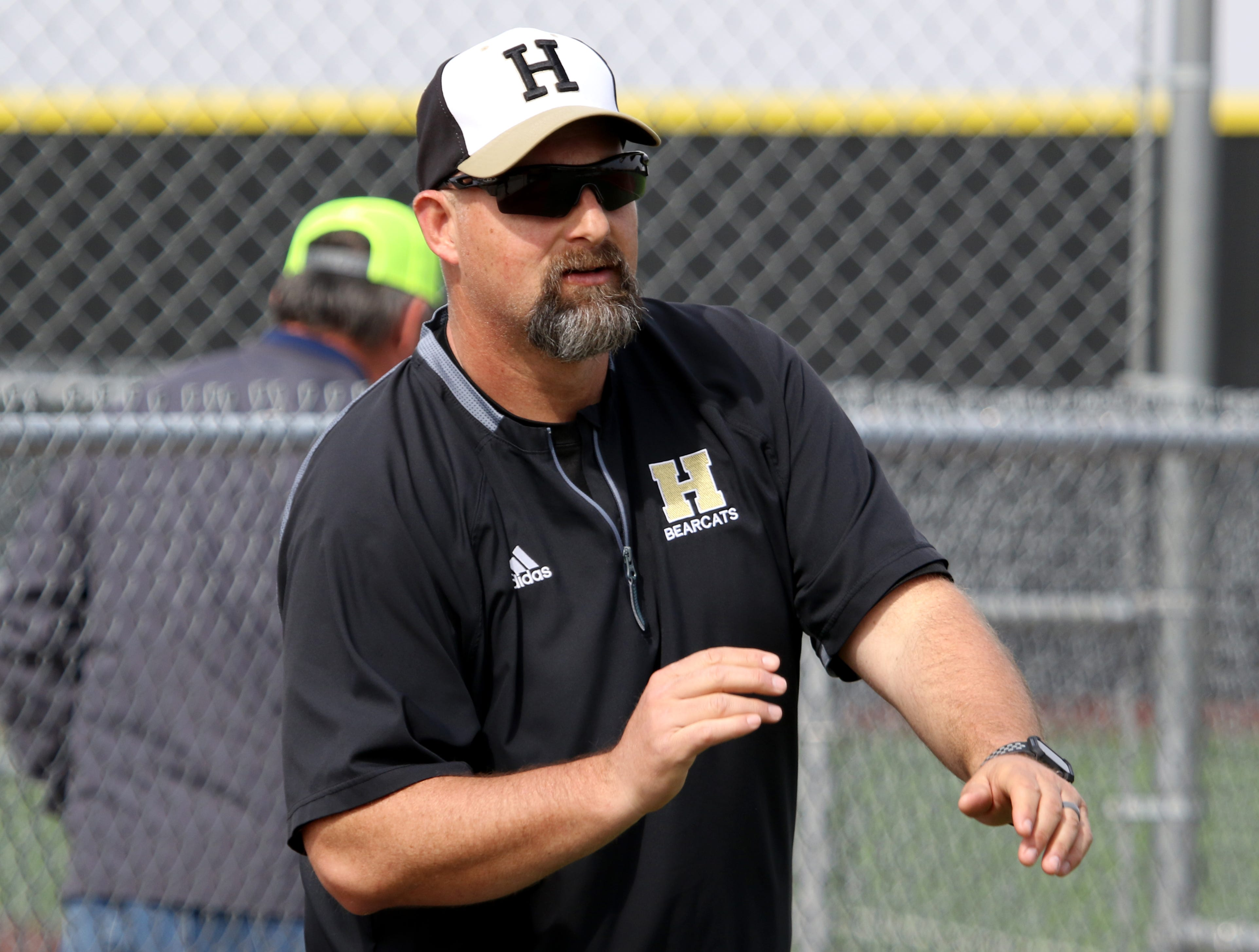 Henrietta head baseball coach Scott Broussard signals to his batter in the game against Burkburnett Friday, March 8 , 2019, in Henrietta.