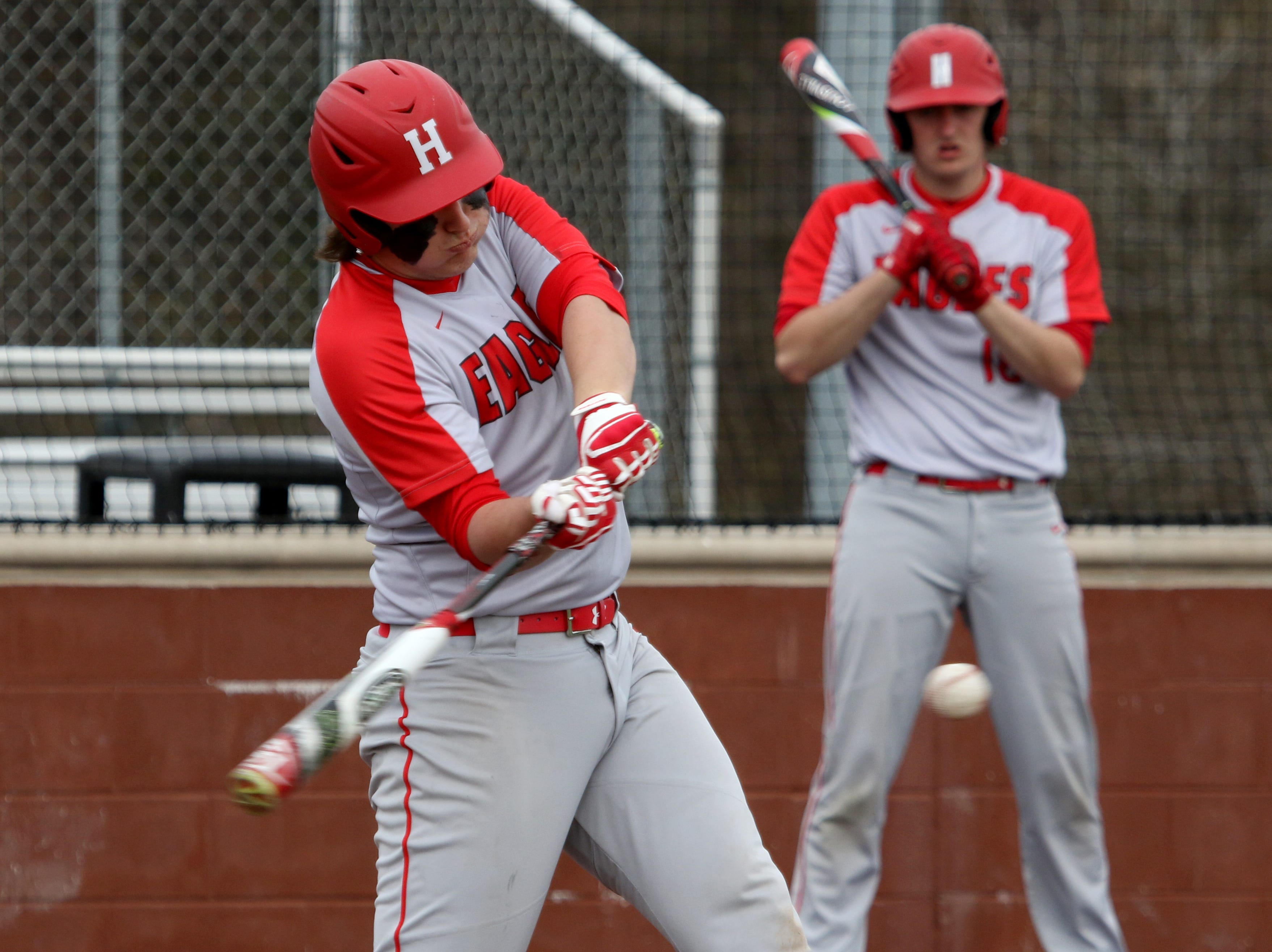 Holliday's Blake Lindemann hits a flyball in the game against Wichita Falls High School Friday, March 8, 2019, in Bowie for the Walker Stallcup Tournament.