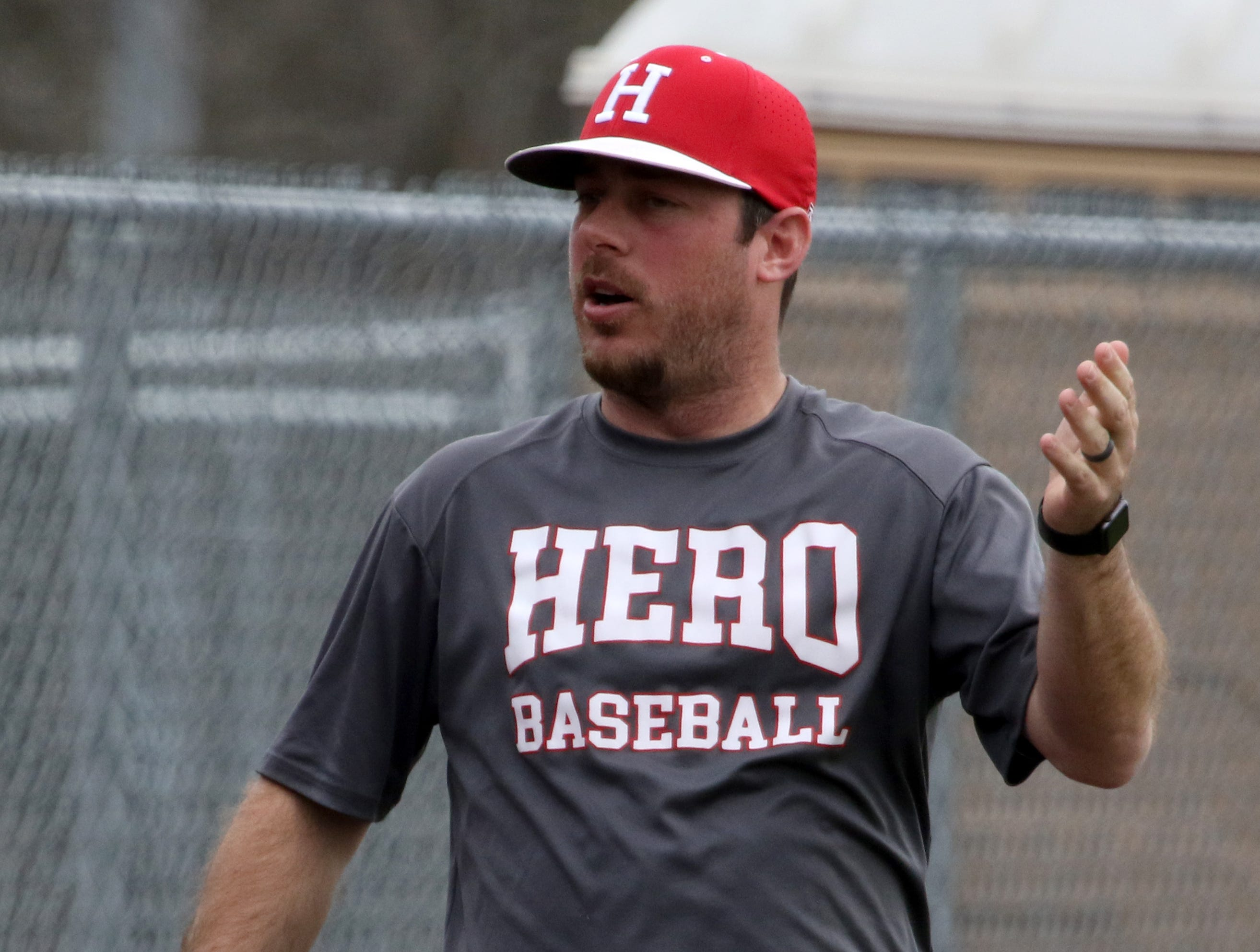 Holliday head baseball coach Brad Blassingame talks to his players in the dugout in the game against Wichita Falls High School Friday, March 8, 2019, in Bowie for the Walker Stallcup Tournament.