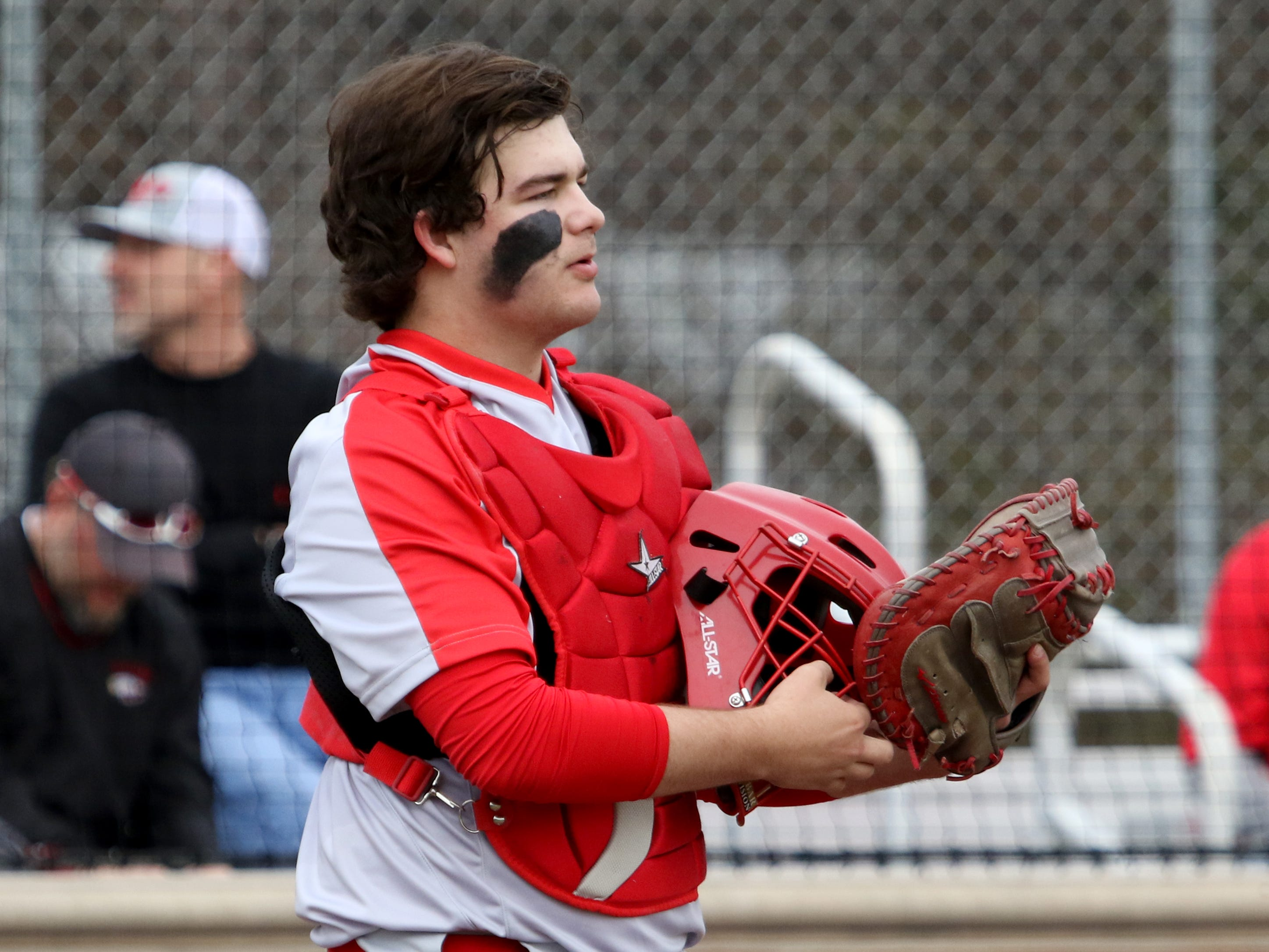 Holliday's Jake Turner puts on his helmet in the game against Wichita Falls High School Friday, March 8, 2019, in Bowie for the Walker Stallcup Tournament.
