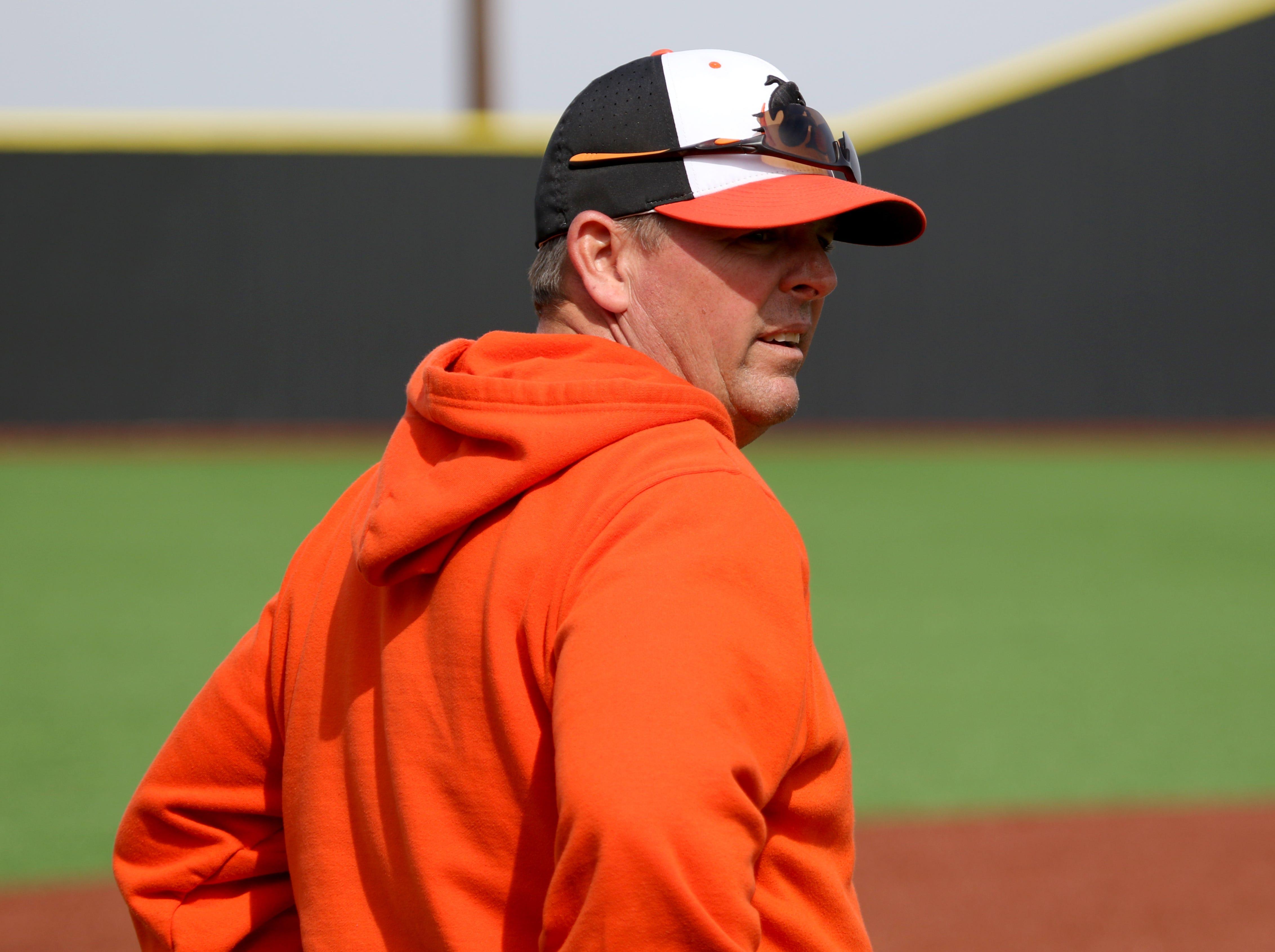 Burkburnett head baseball coach Scot Green watches from the third base box in the game against Henrietta Friday, March 8 , 2019, in Henrietta.
