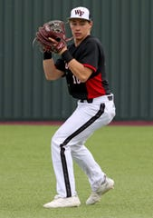 Wichita Falls High School's Zane Leonard gathers the ball before throwing to first in the game against Holliday Friday, March 8, 2019, in Bowie for the Walker Stallcup Tournament.