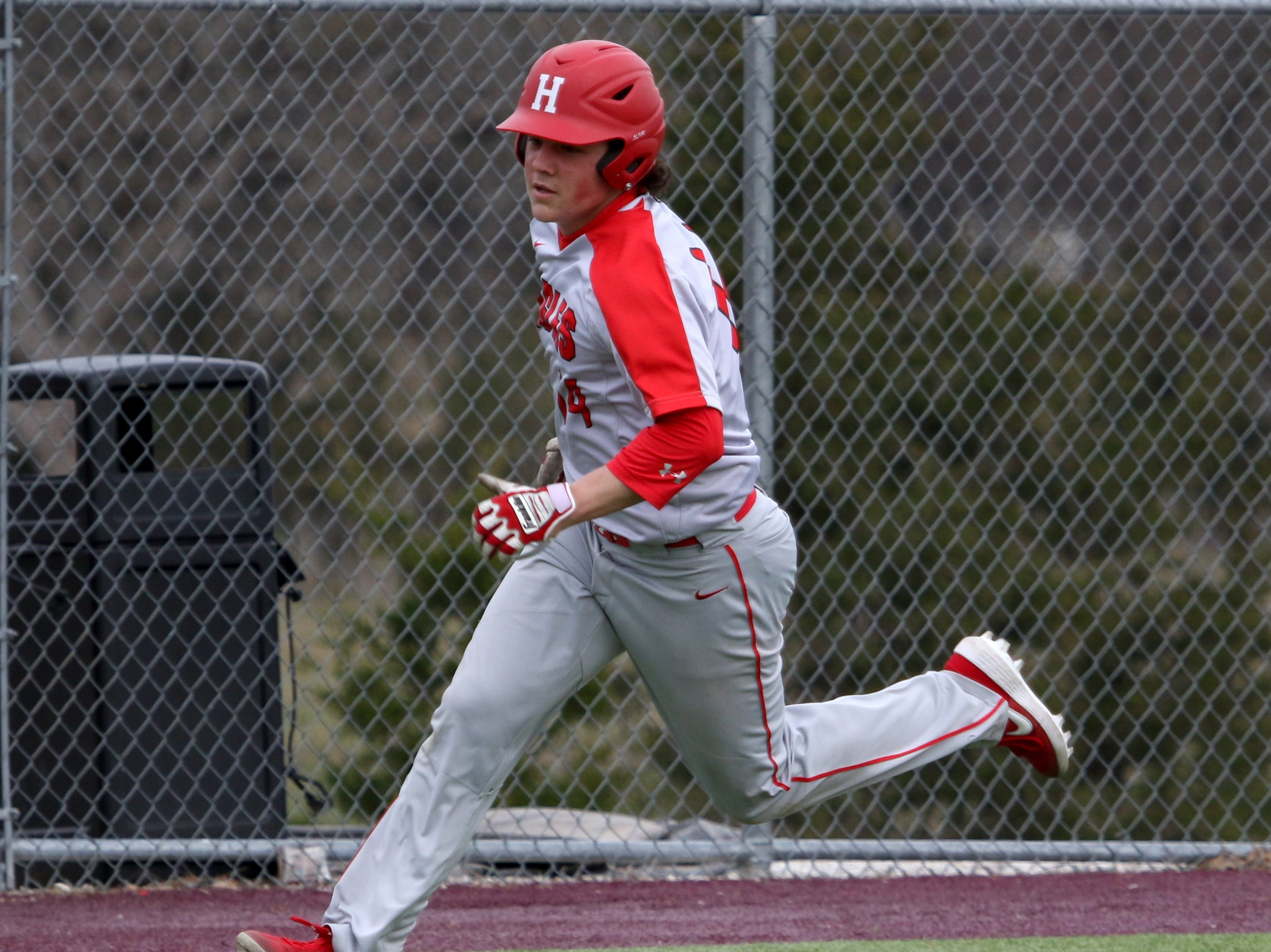 Holliday's Ethan Greer runs home to score the first run against Wichita Falls High School Friday, March 8, 2019, in Bowie for the Walker Stallcup Tournament.