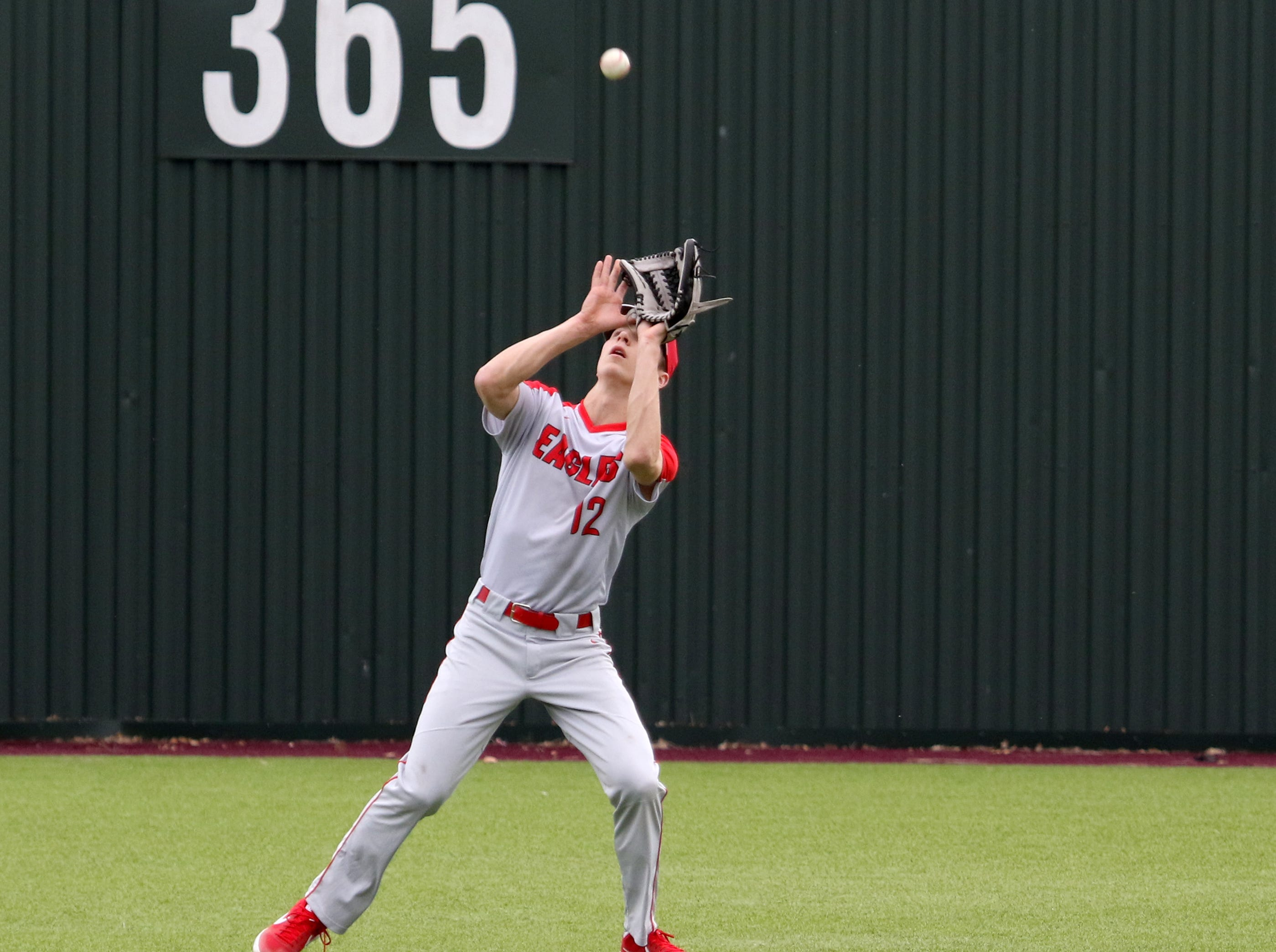Holliday's Connor Cox catches the flyball in the game against Wichita Falls High School Friday, March 8, 2019, in Bowie for the Walker Stallcup Tournament.