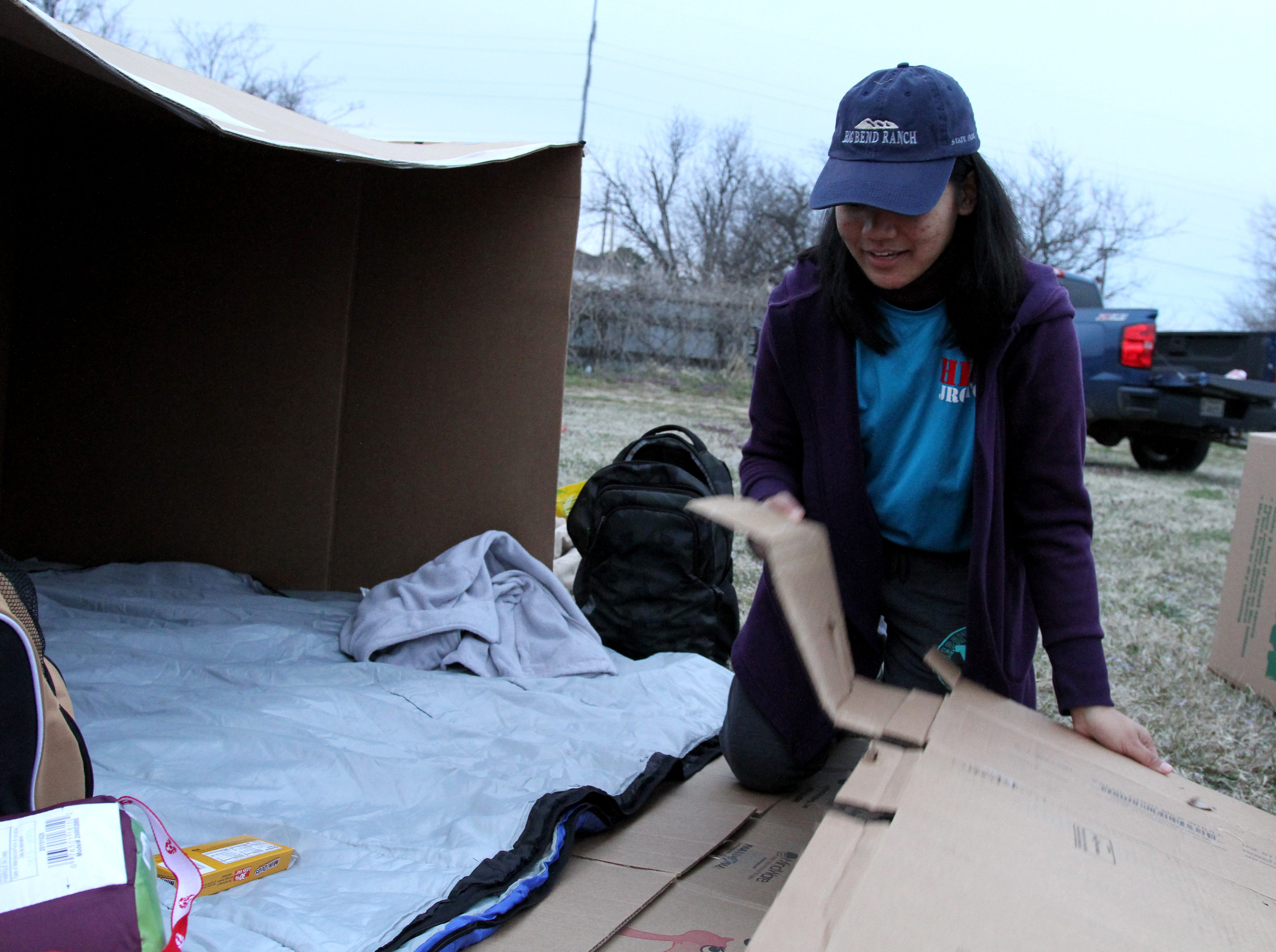 Celine Consuelo, Hirschi JROTC, puts down cardboard during a camp out to raise awareness for homeless veterans Friday, March 8, 2019, at Base Camp Lindsey located at 1909 Old Windthorst Rd.
