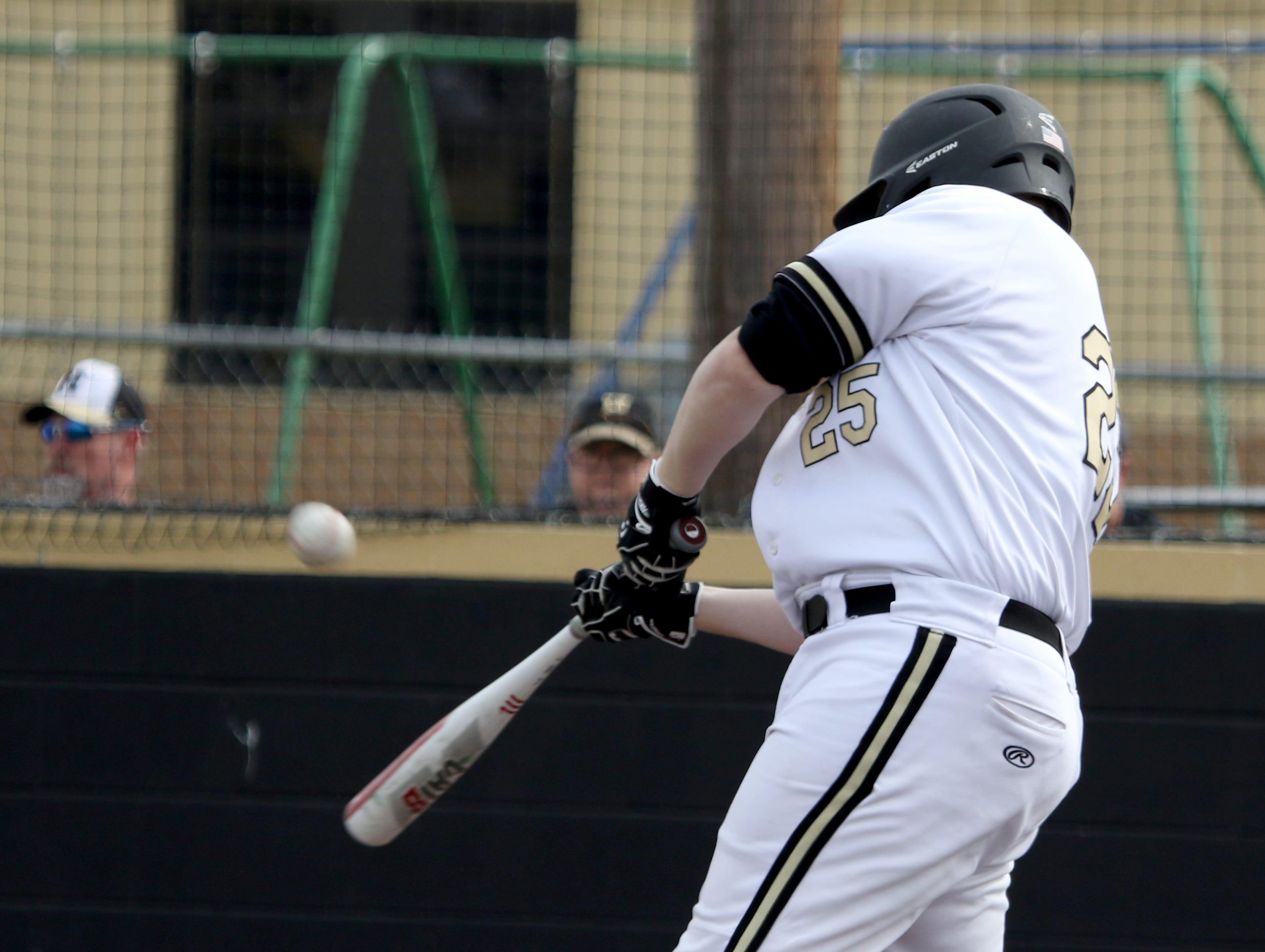 Henrietta's Cooper Watson hits a fly ball in the game against Burkburnett Friday, March 8 , 2019, in Henrietta.