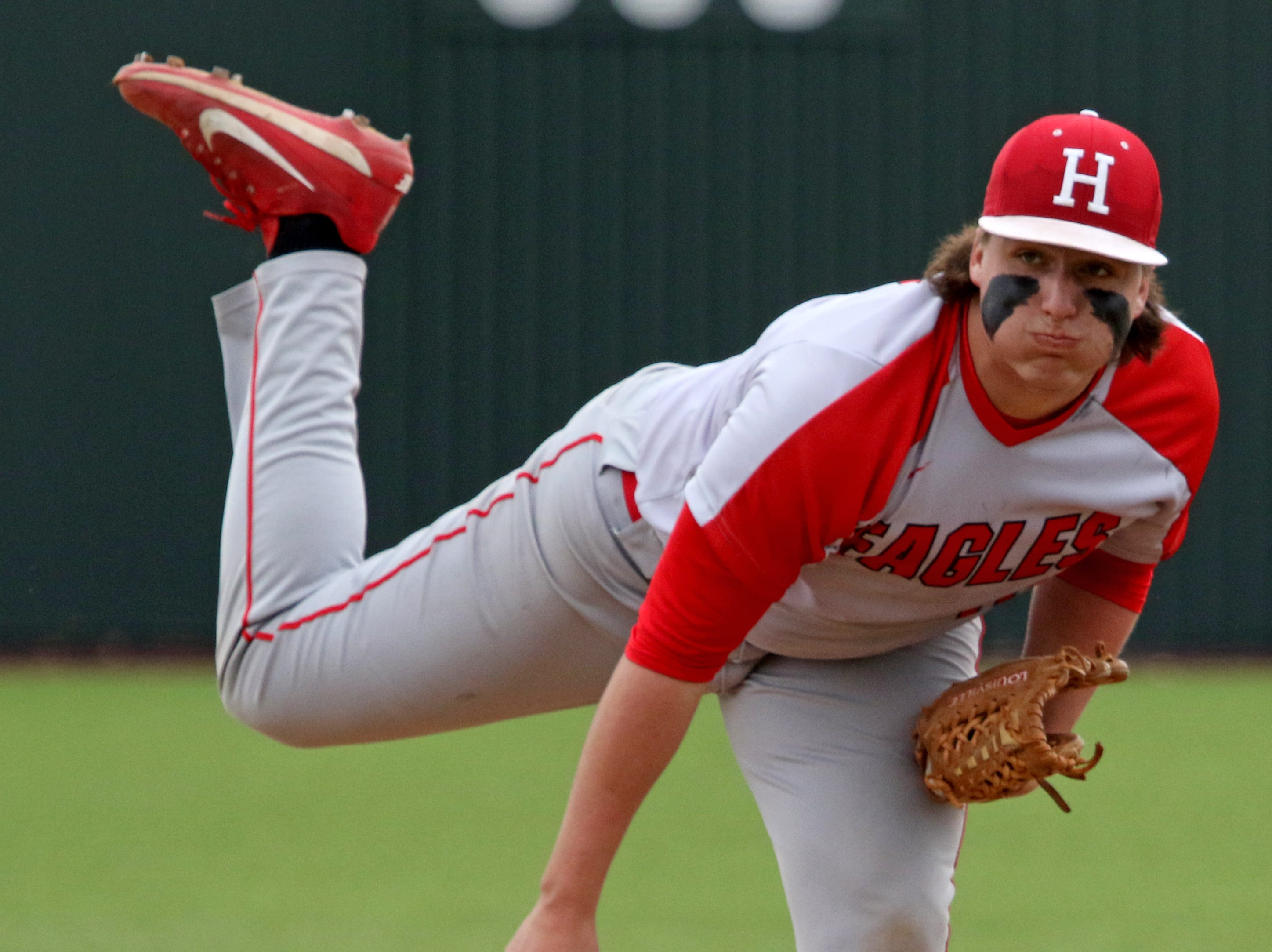Holliday's Blake Lindemann pitches against Wichita Falls High School Friday, March 8, 2019, in Bowie for the Walker Stallcup Tournament.