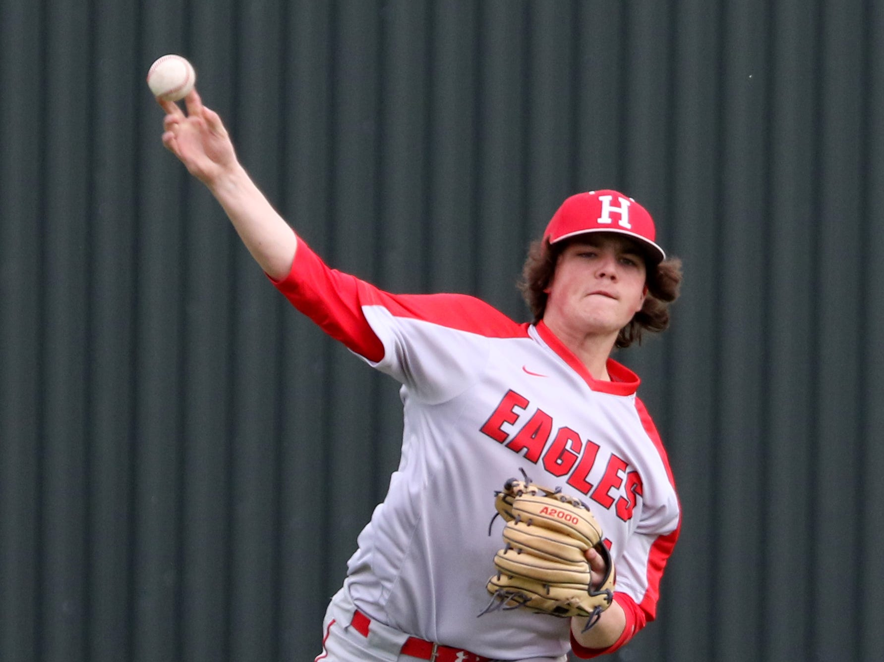 Holliday's Ethan Greer throws to first in the game against Wichita Falls High School Friday, March 8, 2019, in Bowie for the Walker Stallcup Tournament.