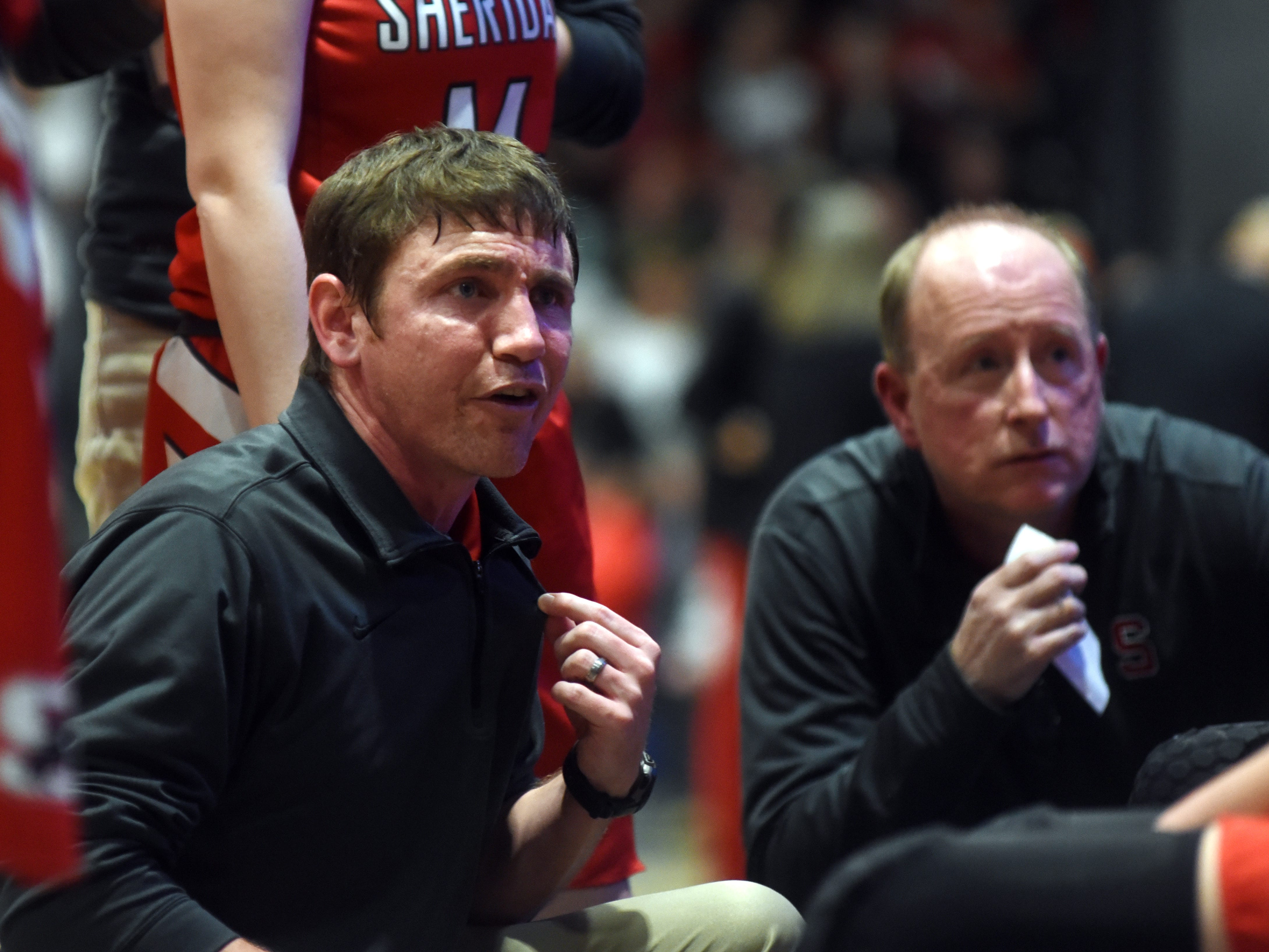 Sheridan coach J.D. Walters talks to his team during a timeout in the fourth quarter. Sheridan reached its first state tournament since 2004 with a 48-46 win against New Philadelphia on Friday night at Winland Memorial Gymnasium.
