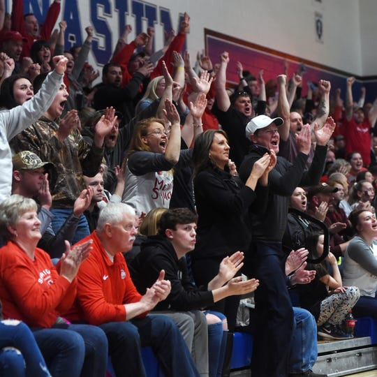 Sheridan fans cheer during the fourth quarter of a 48-46 win against New Philadelphia on Friday night at Winland Memorial Gymnasium.