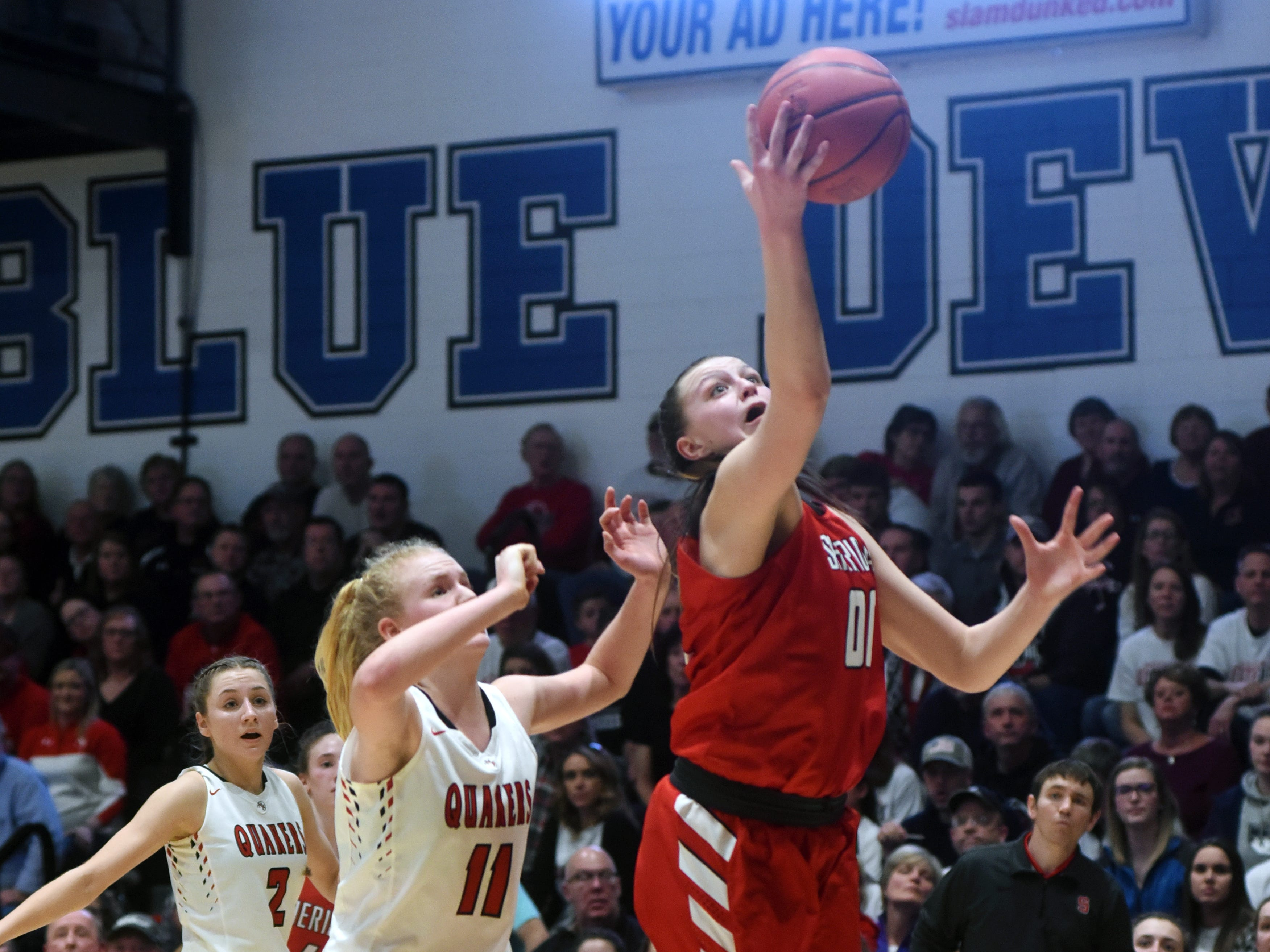 Faith Stinson, of Sheridan, pulls down a rebound against New Philadelphia. Sheridan reached its first state tournament since 2004 with a 48-46 win on Friday night at Winland Memorial Gymnasium.