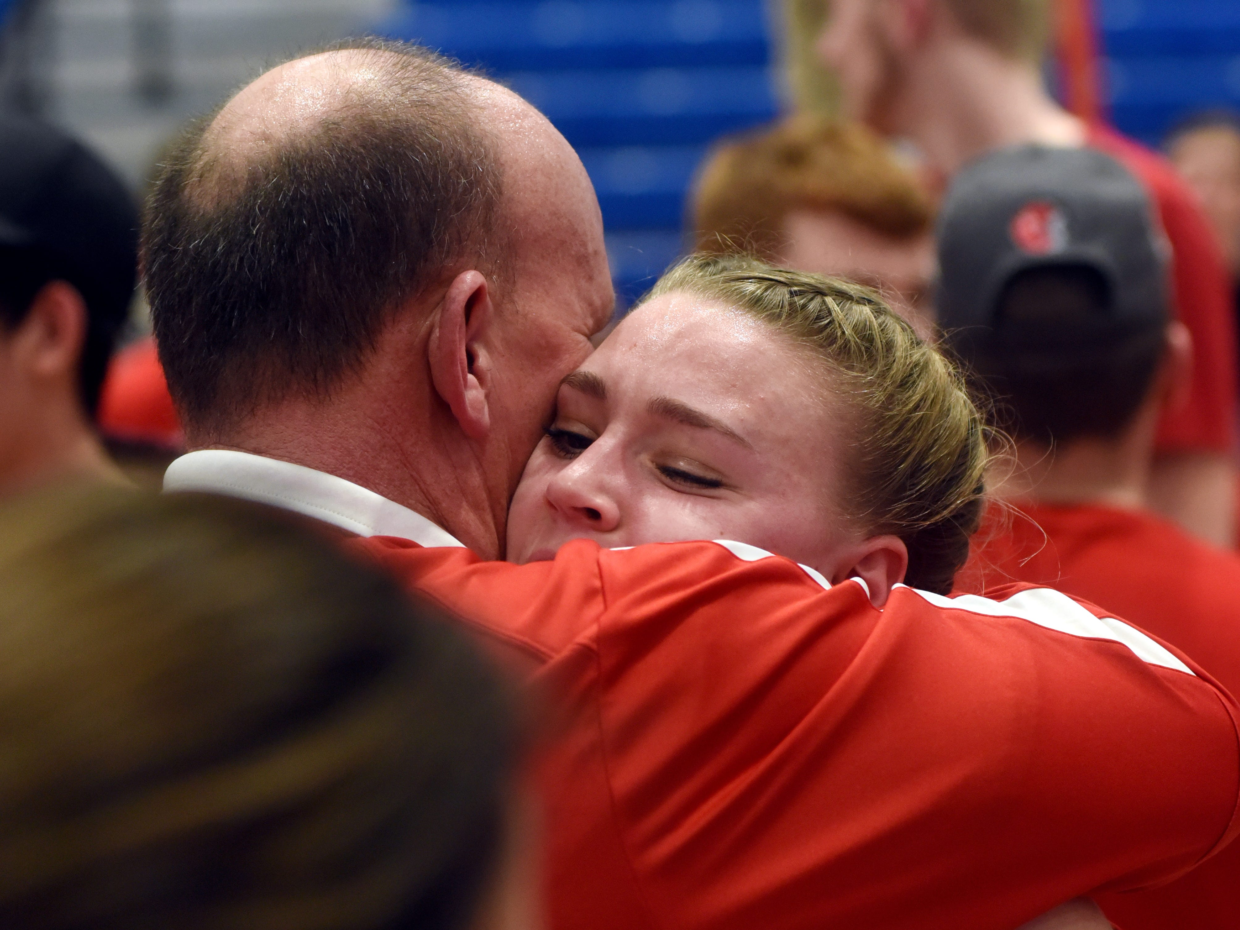 Emma Conrad gets a hug from her father, Jason, following Sheridan's 48-46 win against New Philadelphia on Friday night in a Division II regional final at Winland Memorial Gymnasium.