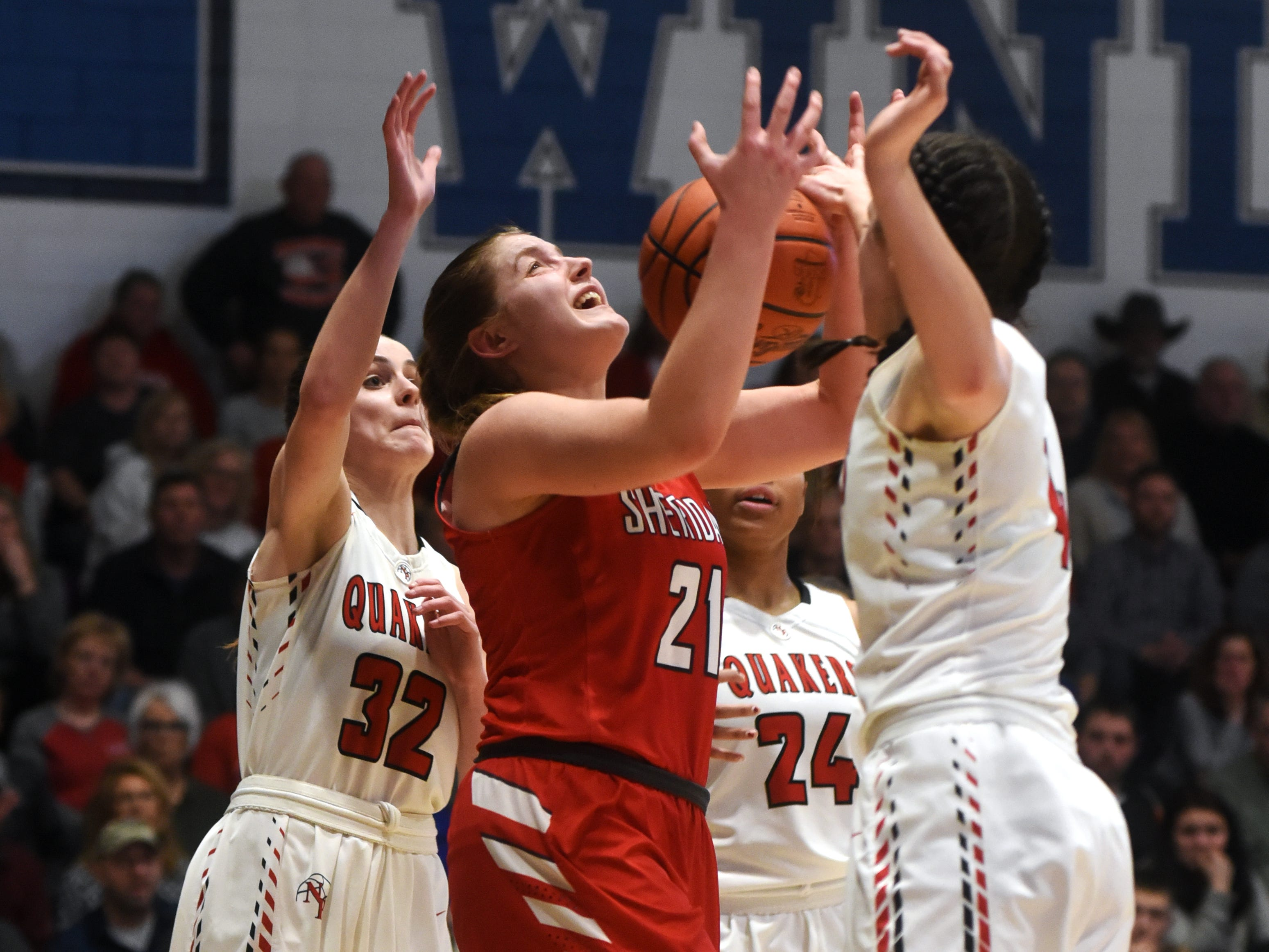 Kendyl Mick goes up for a shot in traffic against New Philadelphia in a Division II regional final on Friday night at Winland Memorial Gymnasium. The Generals reached their first state tournament since 2004 with a 48-46 win.