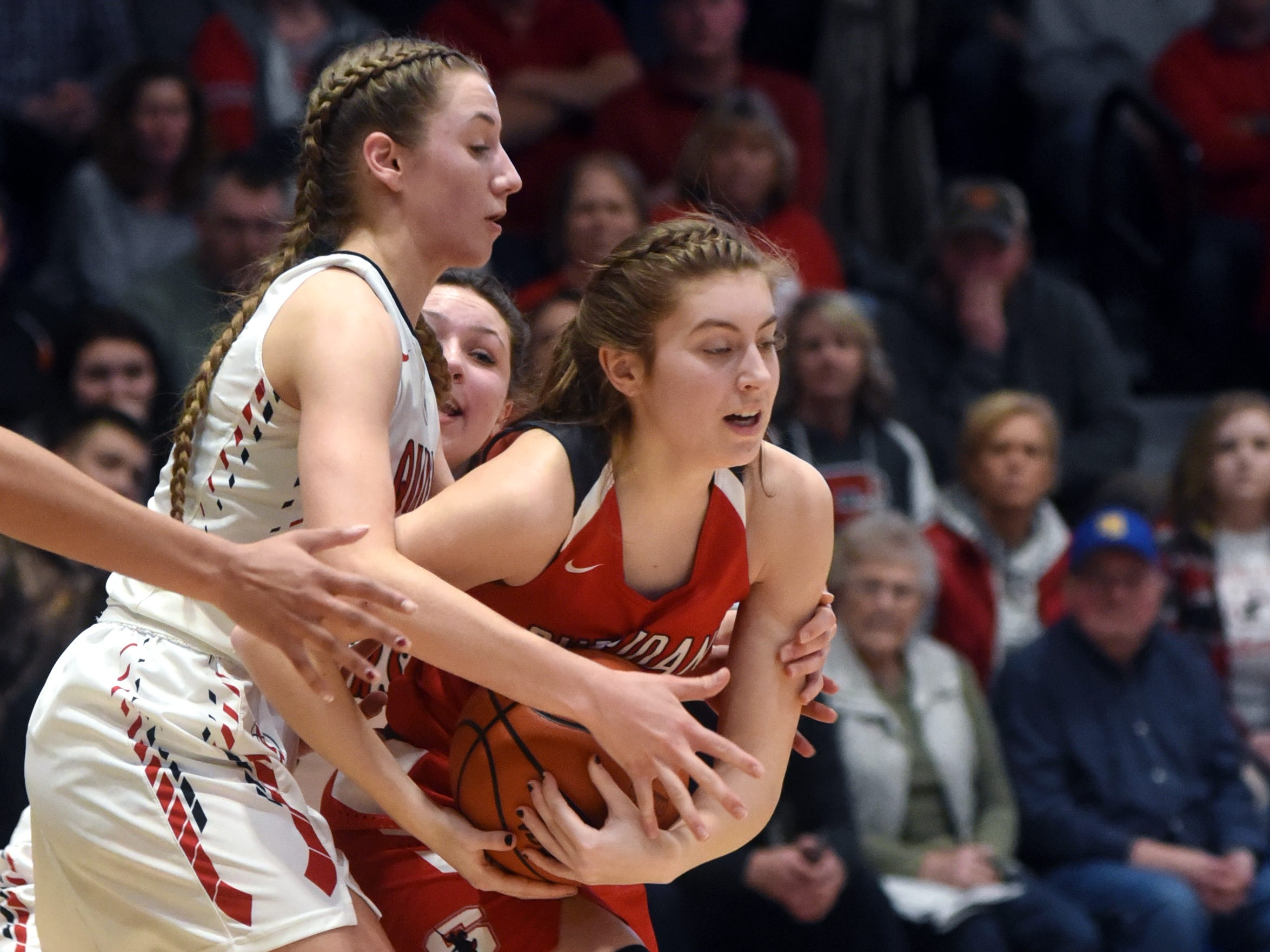 Aubrie White, of Sheridan, is tied up by a New Philadelphia defender during the Generals' 48-46 win on Friday night at Winland Memorial Gymnasium.
