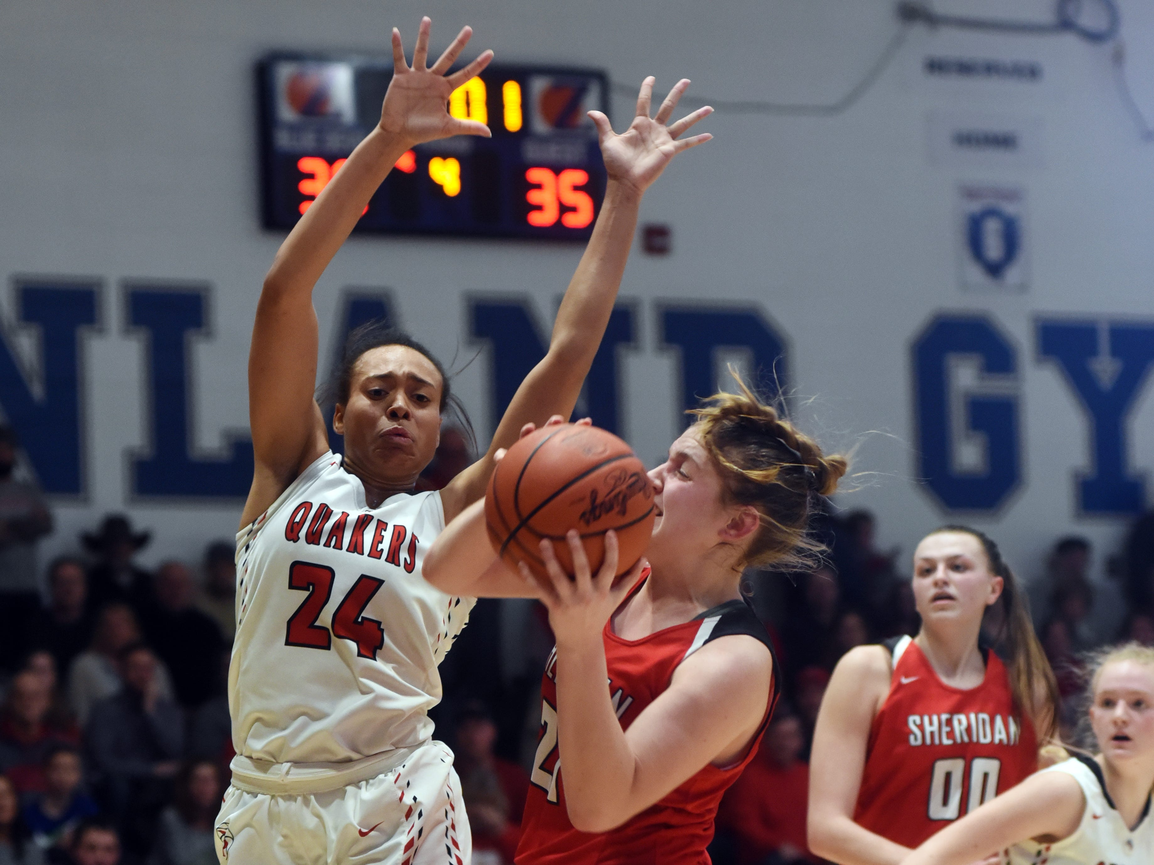 Sheridan's Kendyl Mick is met in the lane by New Philadelphia's Aaliyah Currence during a Division II regional final at Winland Memorial Gymnasium. The Generals reached their first state tournament since 2004 with a 48-46 win.
