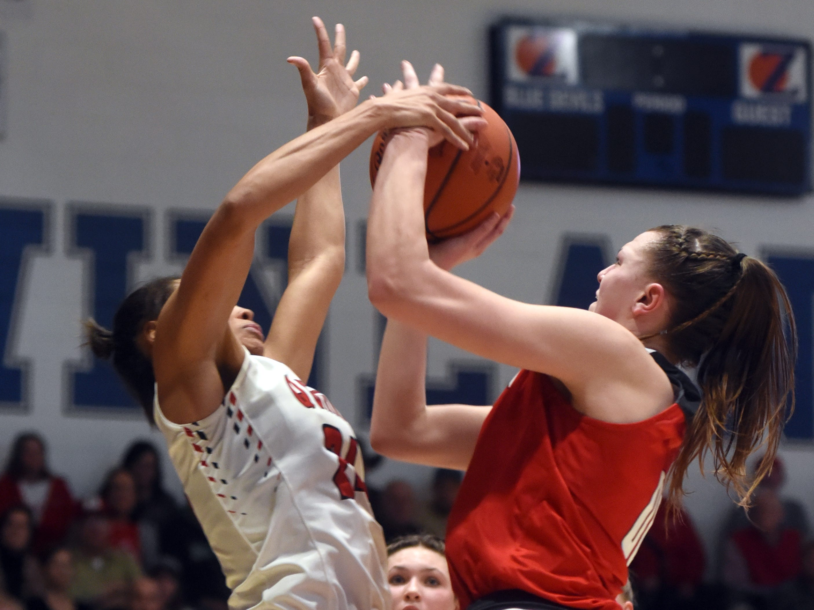 Faith Stinson, of Sheridan, is blocked during a shot in the lane against New Philadelphia's Aaliyah Currence during a Division II regional final at Winland Memorial Gymnasium. The Generals reached their first state tournament since 2004 with a 48-46 win.