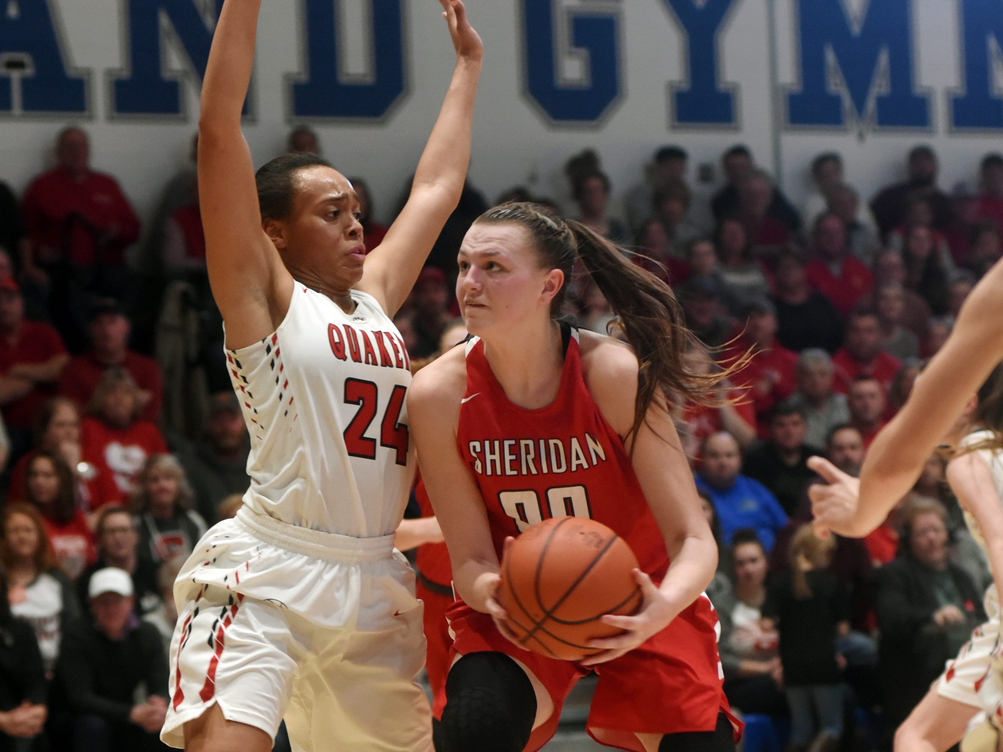 Faith Stinson, of Sheridan, prepares to take a shot in the lane against New Philadelphia's Aaliyah Currence during a Division II regional final at Winland Memorial Gymnasium. The Generals reached their first state tournament since 2004 with a 48-46 win.