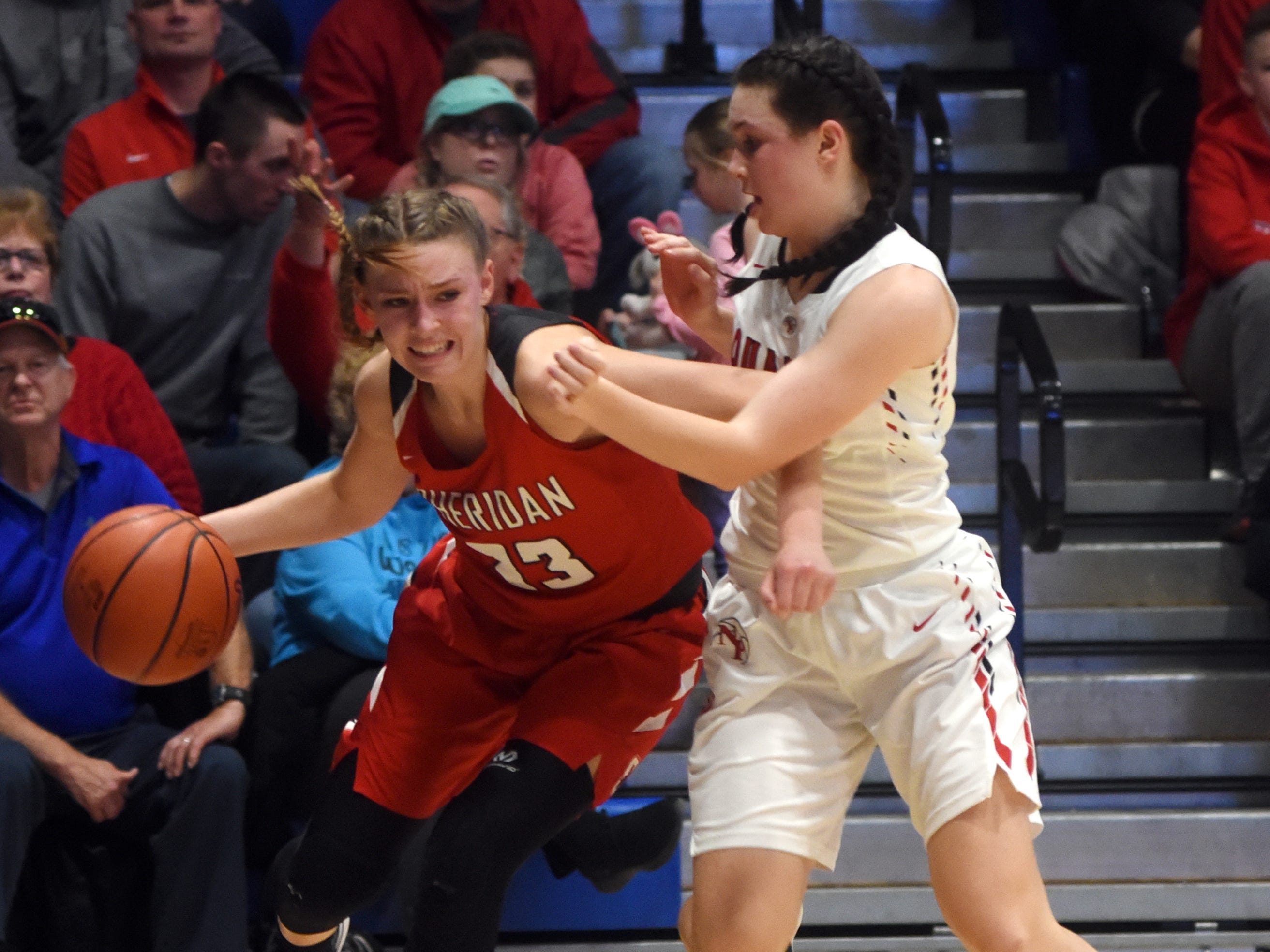 Sheridan's Emma Conrad drives the baseline against New Philadelphia on Friday night in a Division II regional final at Winland Memorial Gymnasium. The Generals reached their first state tournament since 2004 with a 48-46 win.