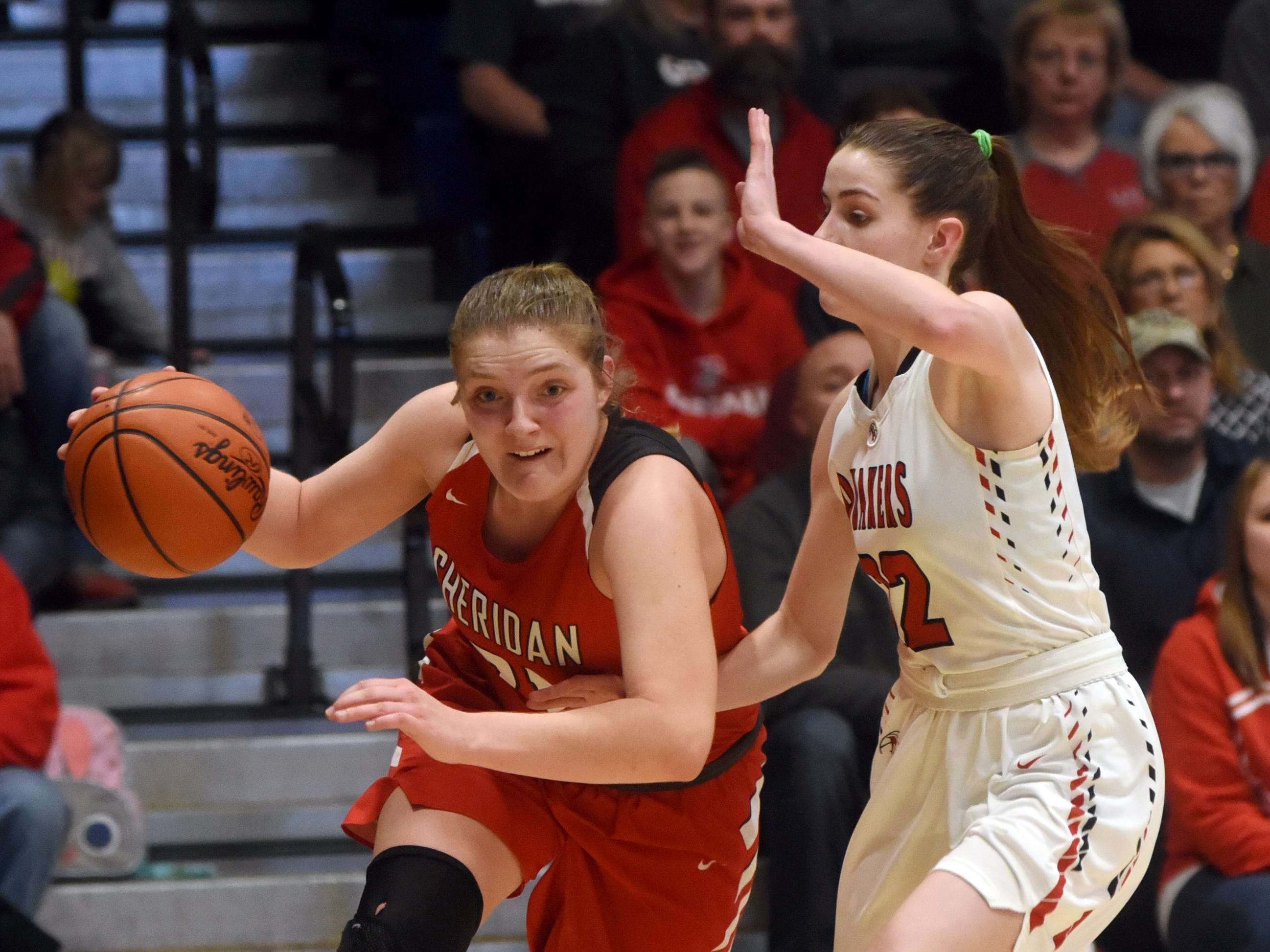Sheridan's Kendyl Mick drives the baseline against New Philadelphia on Friday night in a Division II regional final at Winland Memorial Gymnasium. The Generals reached their first state tournament since 2004 with a 48-46 win.