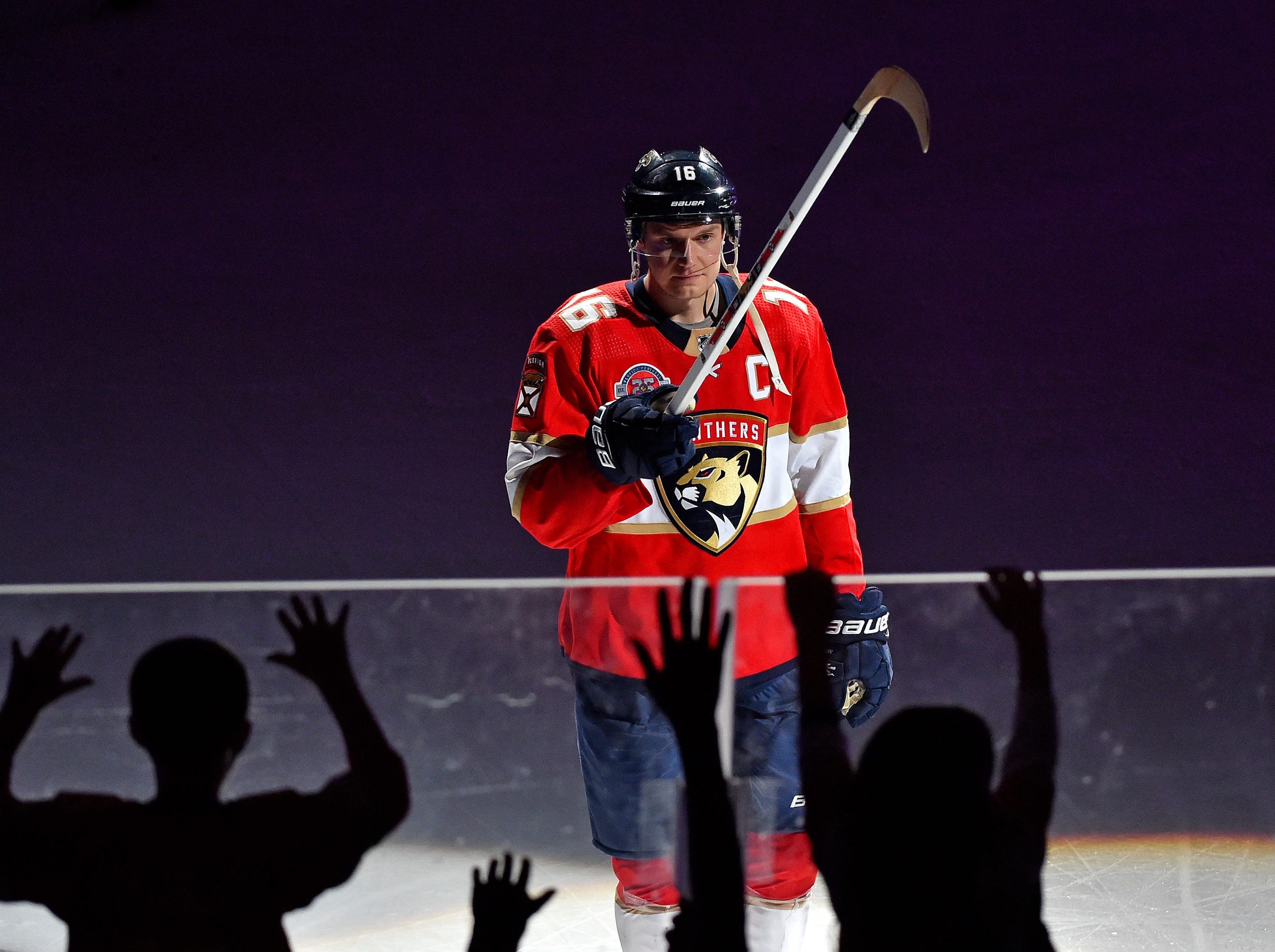 March 8: Florida Panthers center Aleksander Barkov gives his hockey stick to fans after a 6-2 win against the Minnesota Wild. He set a franchise record with five assists in the game.