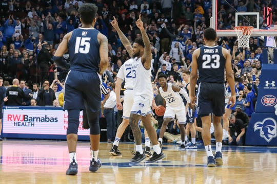 Seton Hall's Myles Powell (13) celebrates after beating Villanova.